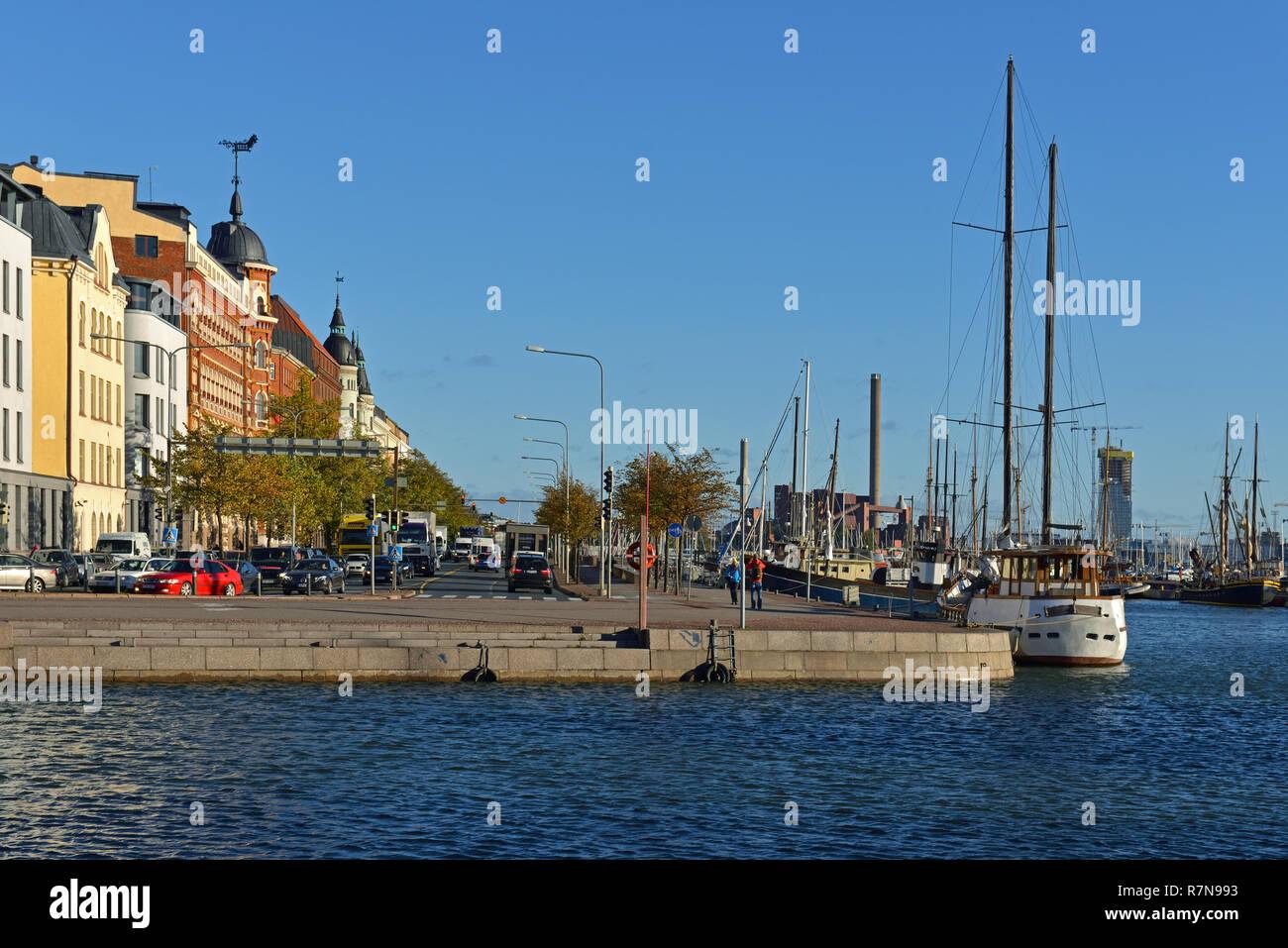 Pohjoisranta embankment, road and harbor with old yacht and ships. Katajanokka - Stock Image