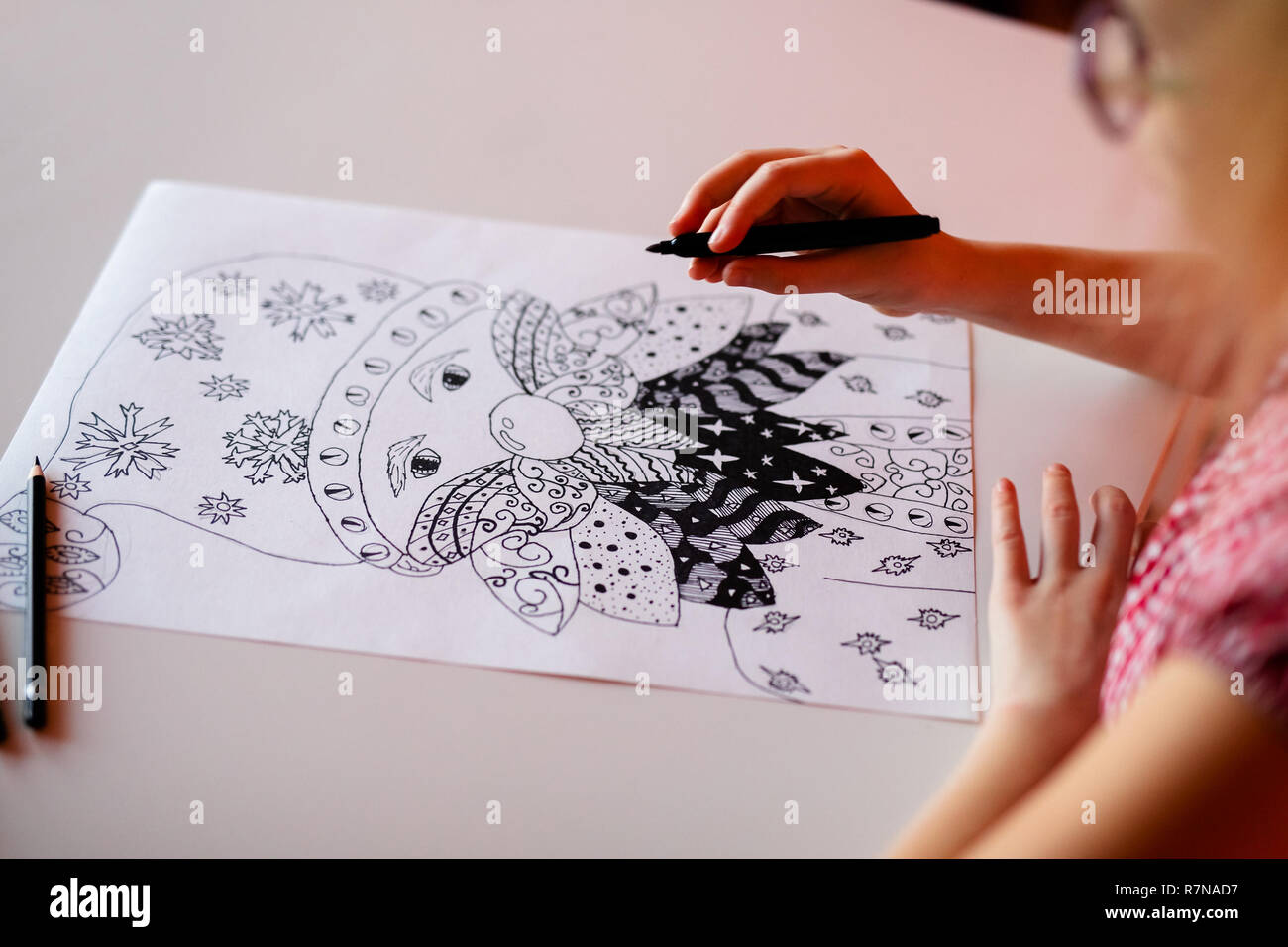 Close up hand with pencil drawing christmas pictures new year theme bokeh and golden balls