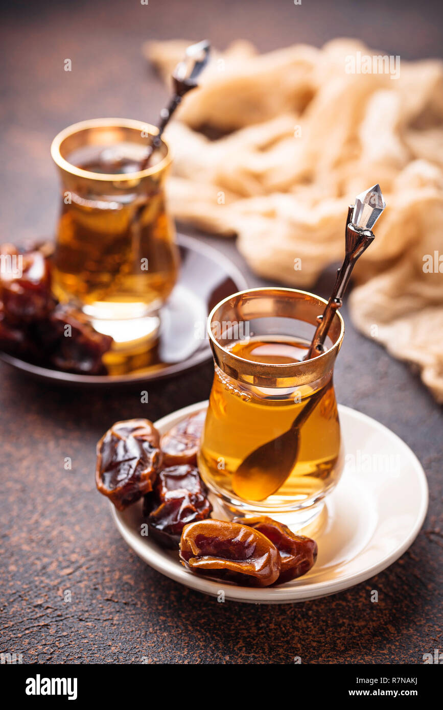 Traditional arabic tea and dry dates - Stock Image