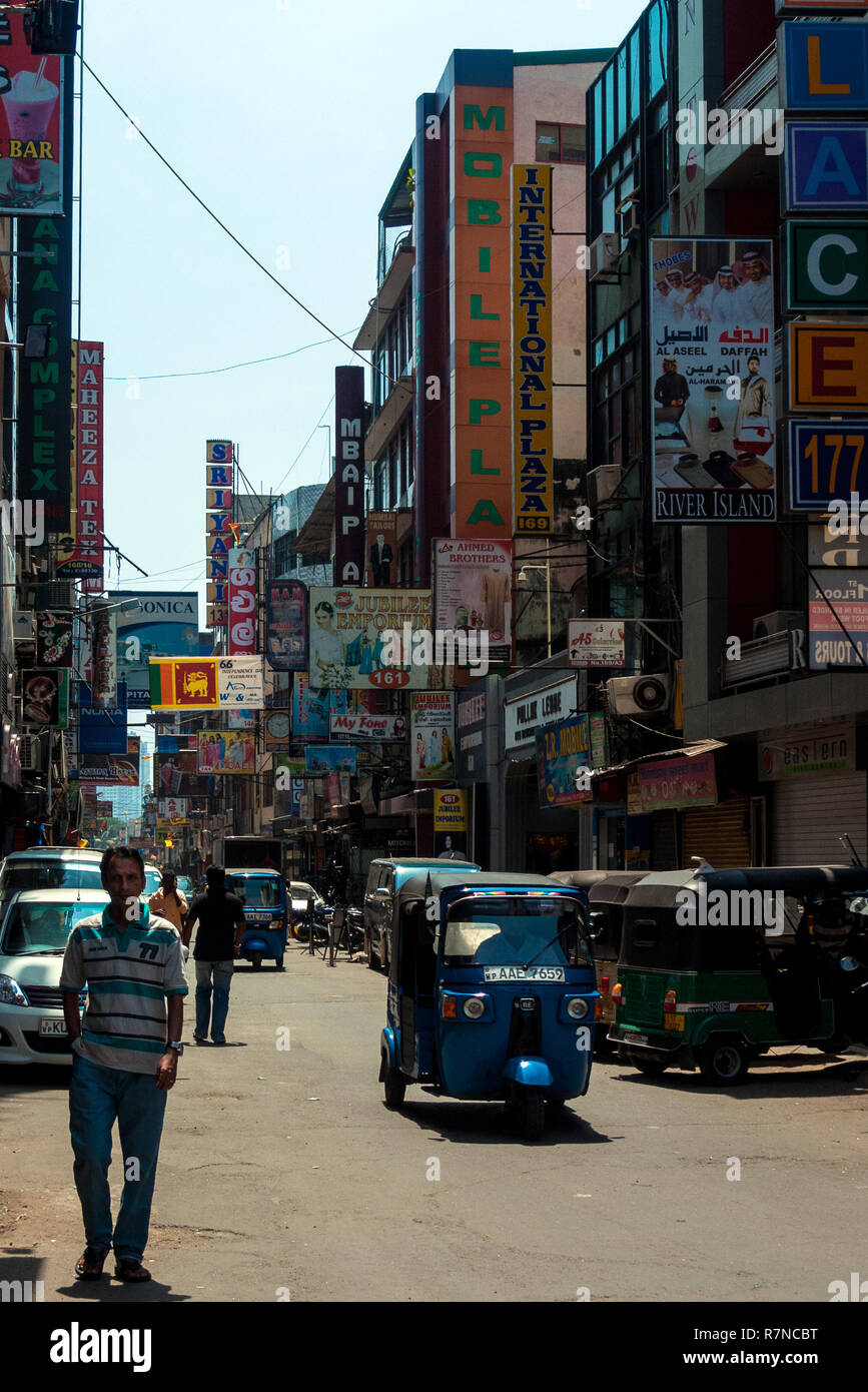 Colombo, Sri Lanka, 02/16/2014: a street in the city of Colombo with many signs on the sides of the buildings - Stock Image