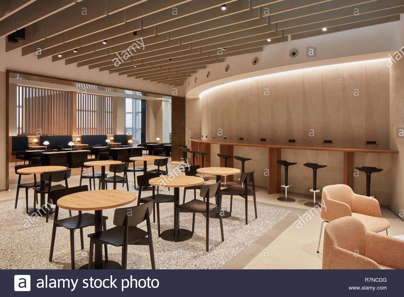 Seating at British Airways Executive Lounge Rome. British Airways Executive Lounge Rome, Fiumicino, Italy. Architect: Universal Design Studio, 2018. - Stock Image