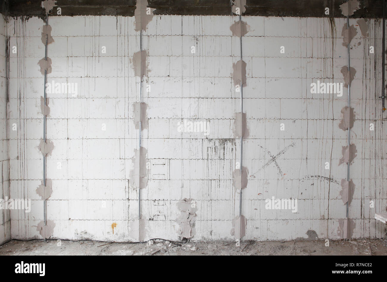 Preparing walls for plastering house  walls with metal holders interior. Stock Photo