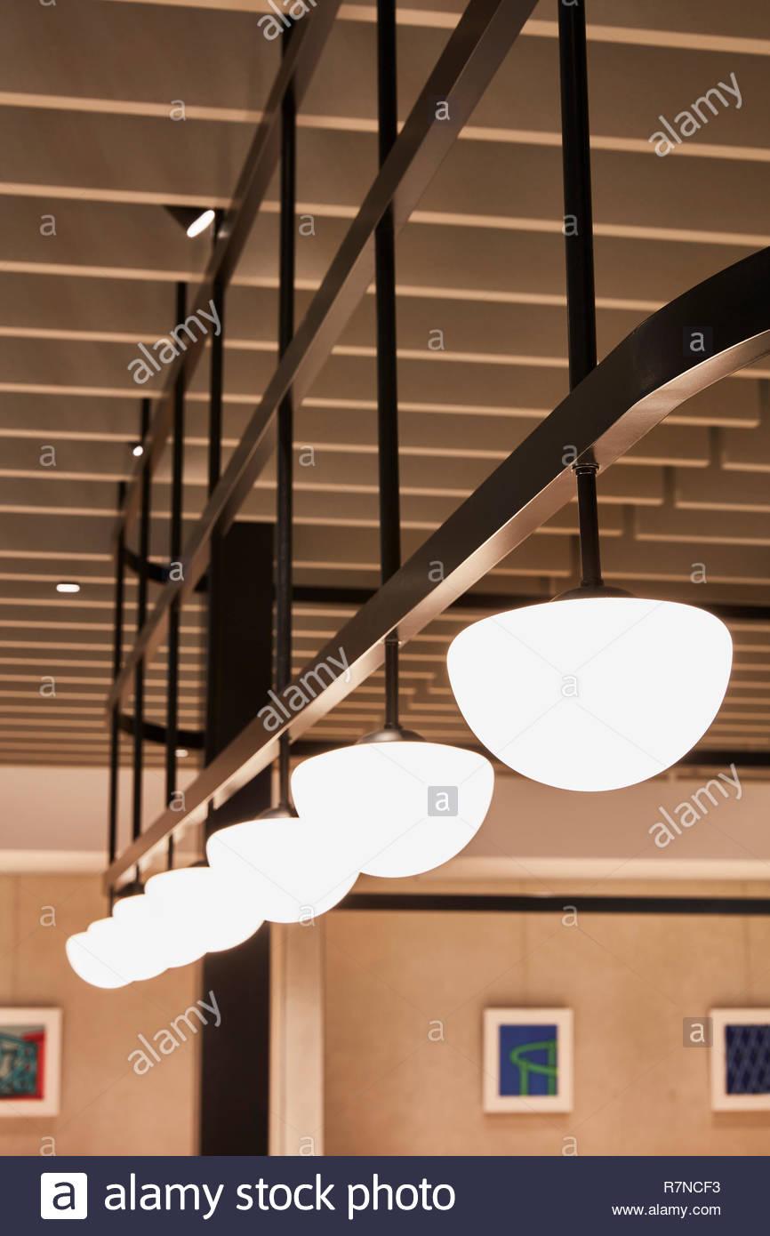 Lights at British Airways Executive Lounge Rome. British Airways Executive Lounge Rome, Fiumicino, Italy. Architect: Universal Design Studio, 2018. - Stock Image
