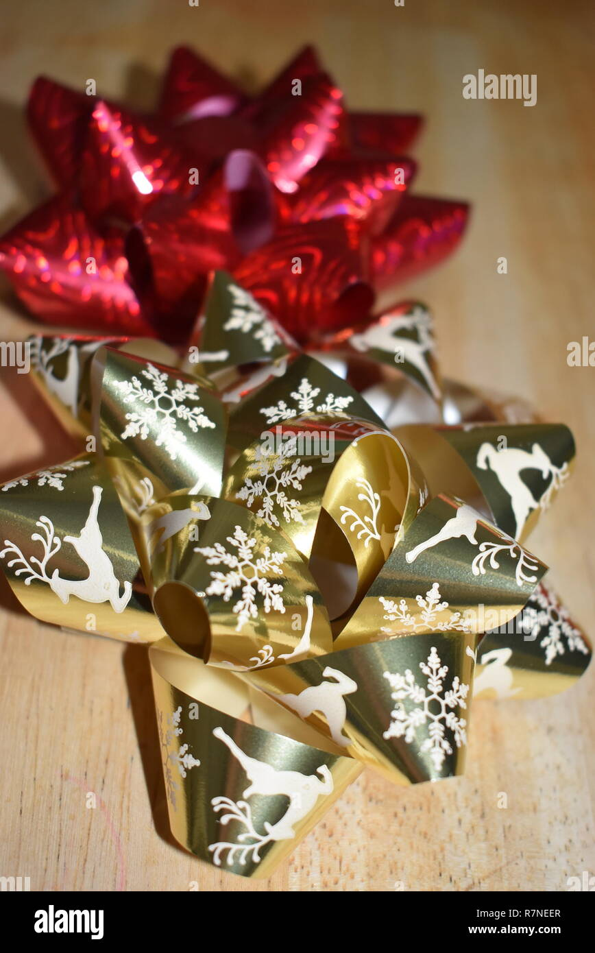 Gold and Red Christmas Bows - Stock Image