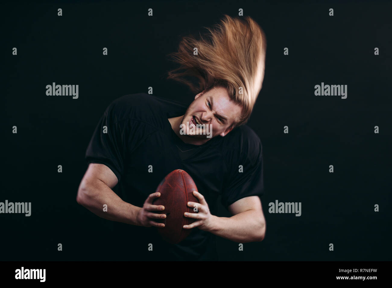 American football player about to throw the ball - Stock Image