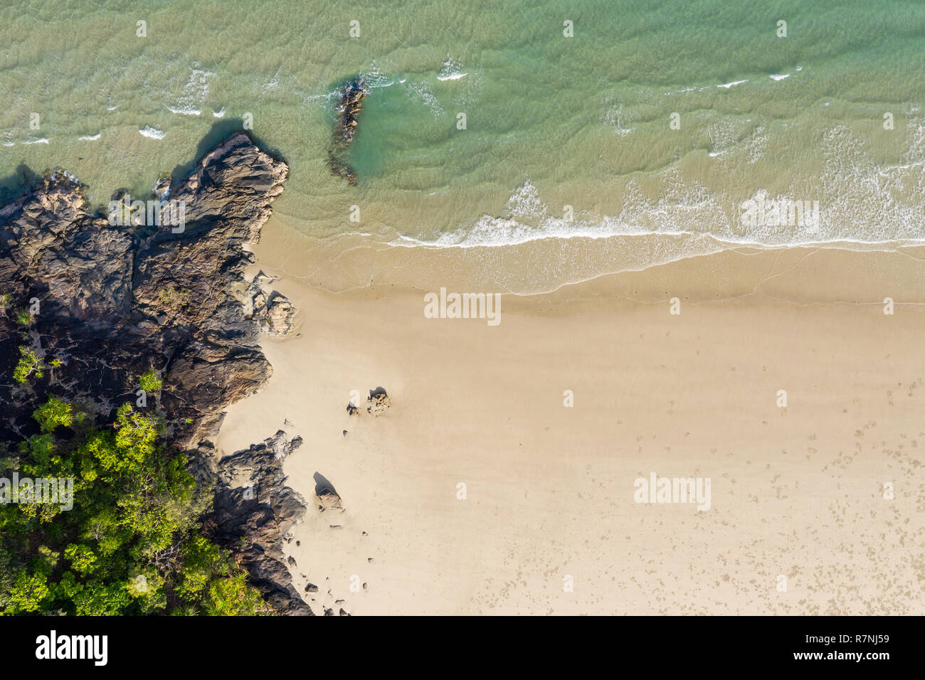 An aerial view of Noah Beach Daintree region in afr north Queensland. Angled directly down. This stretch of coast the rain forest grows right down to  - Stock Image