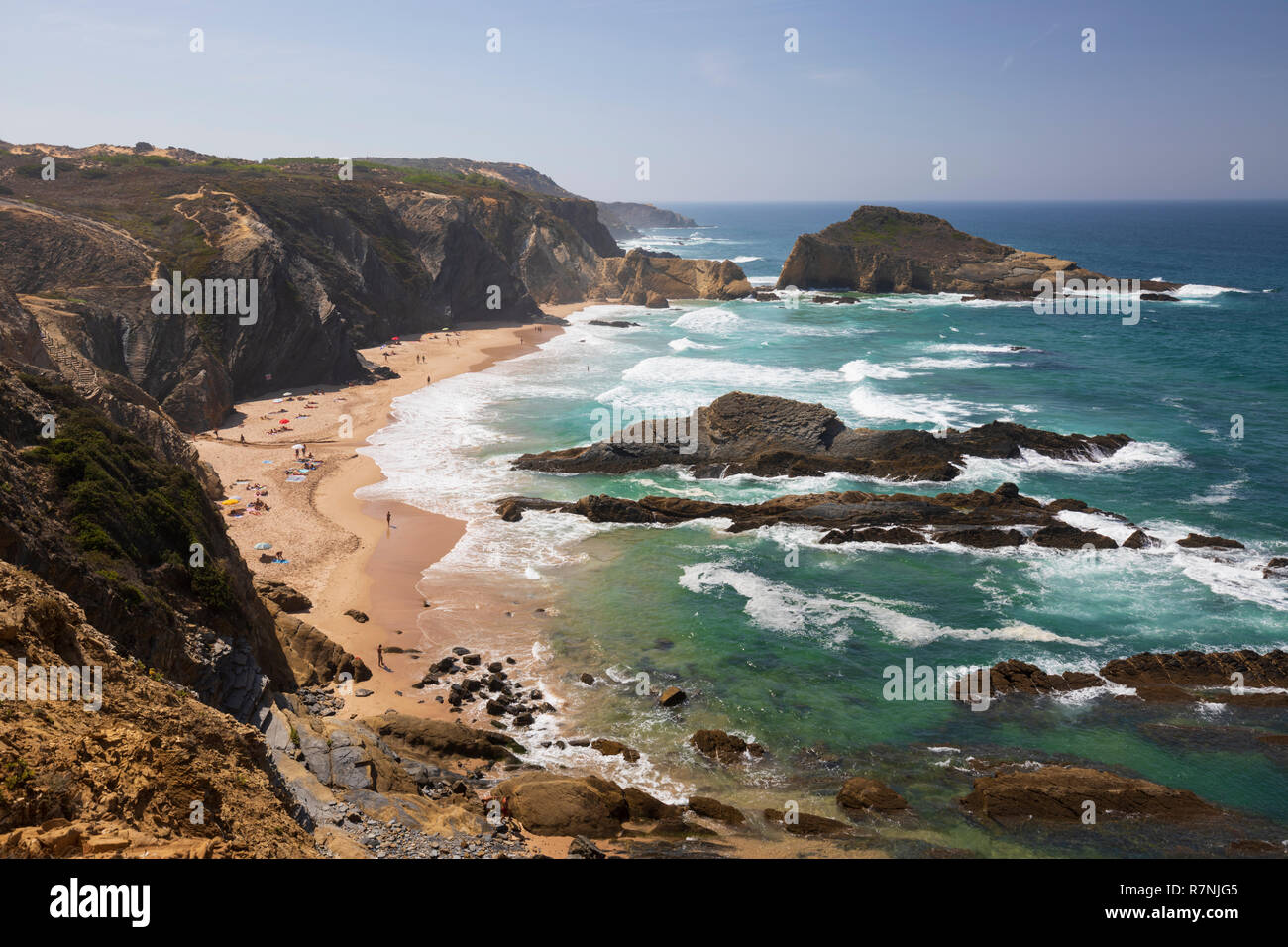 Praia dos Alteirinhos and view along rugged Atlantic coastline, Zambujeira do Mar, Alentejo region, Portugal, Europe - Stock Image