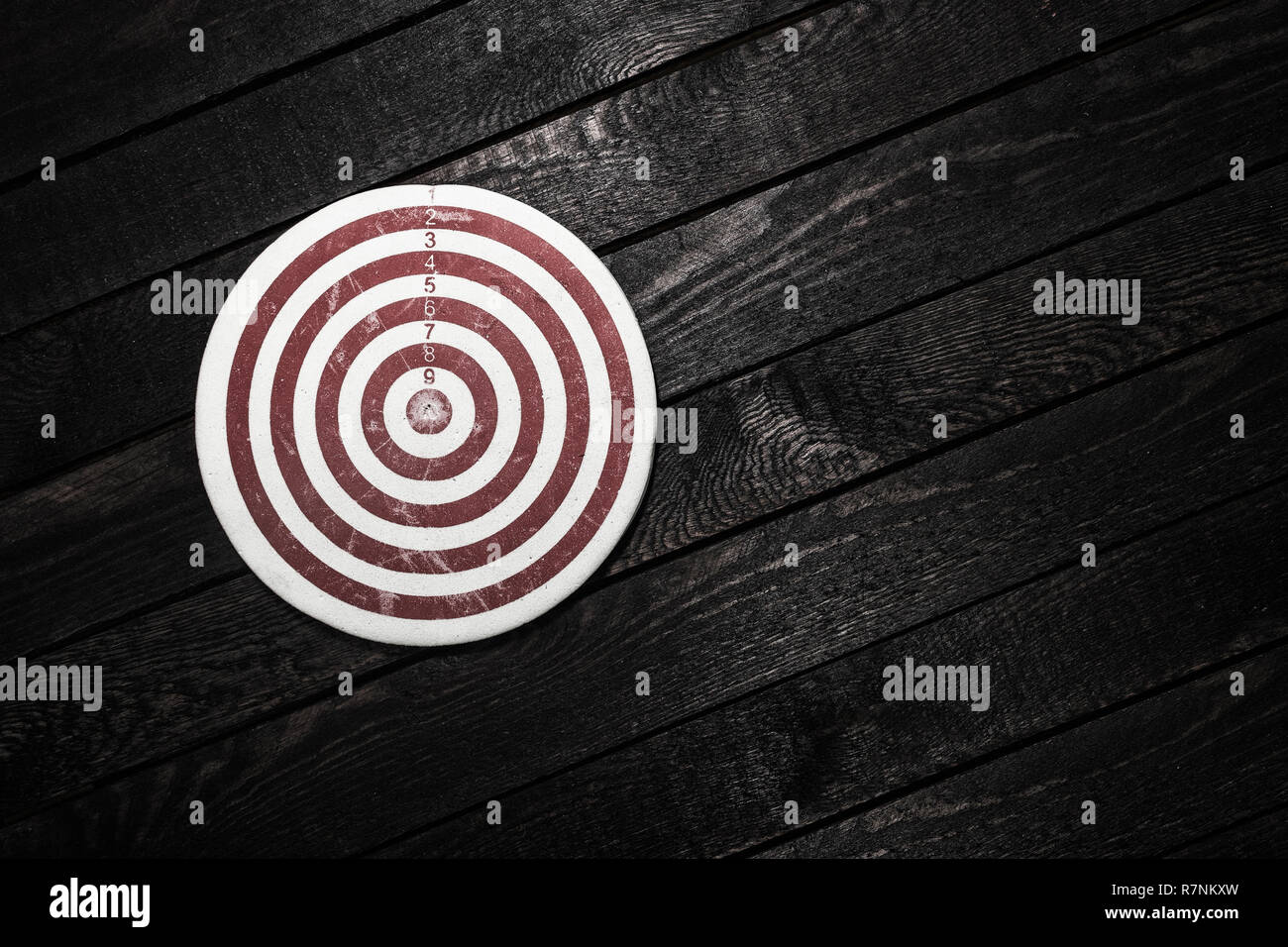 Business achievements concept. Dart on wooden background - Stock Image