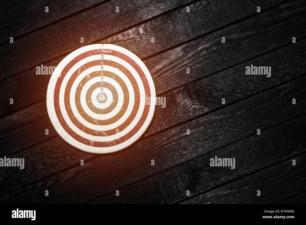 Dart board on dark wooden table. Business concept. - Stock Image