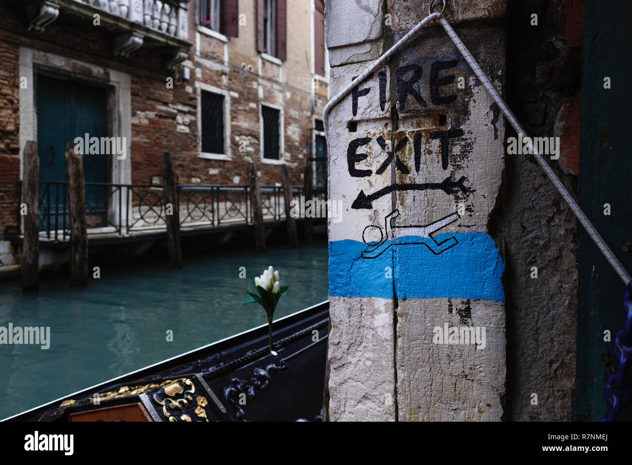 I love easy and obvious solutions. In Venice, in the Acqua Alta bookshop, the fire escape is simply a door that leads directly into a canal. Libreria  - Stock Image