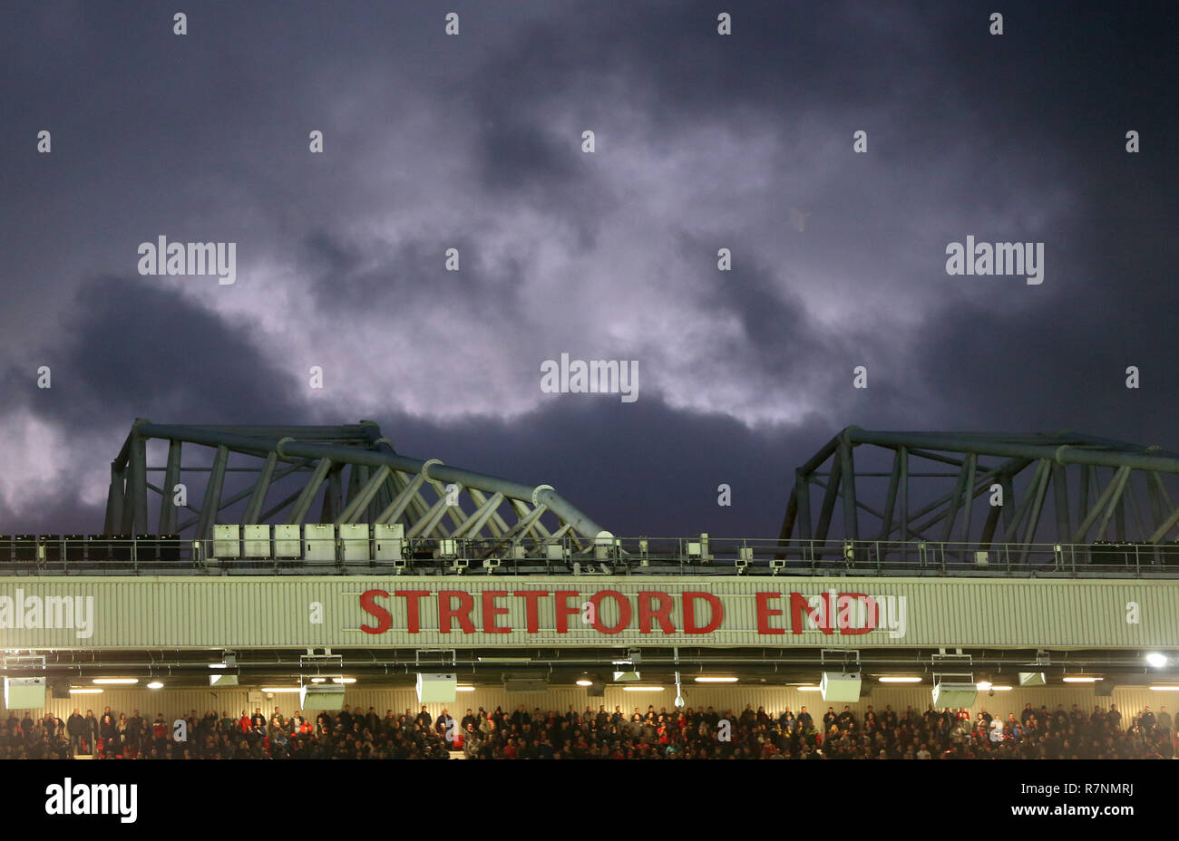 General view of fans in the Stretford End during the match - Stock Image