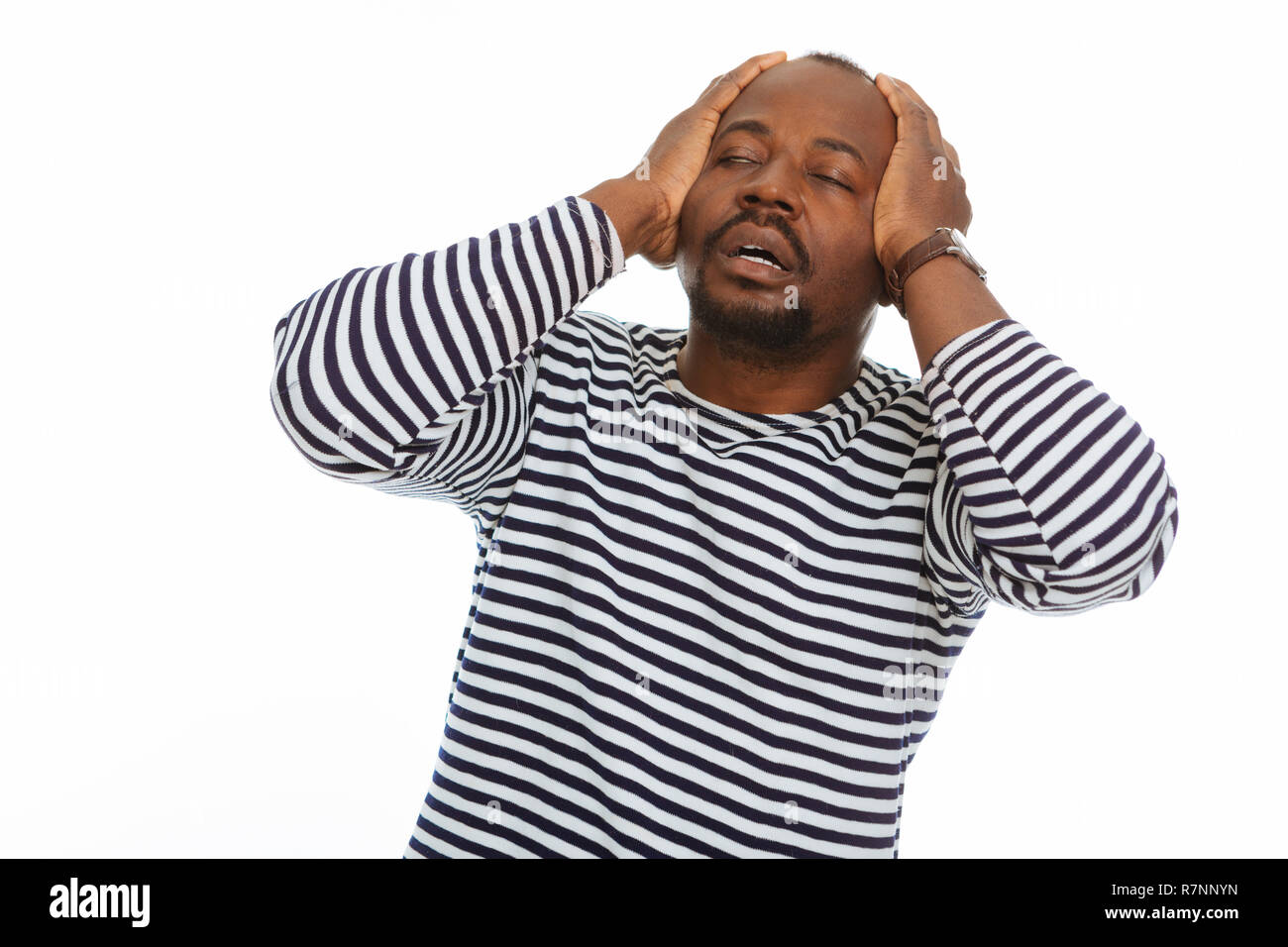 Cheerless afro American man holding his head - Stock Image