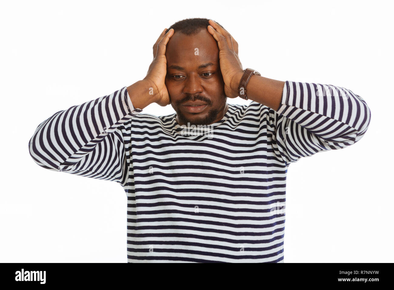 Depressed nice man suffering from a headache - Stock Image