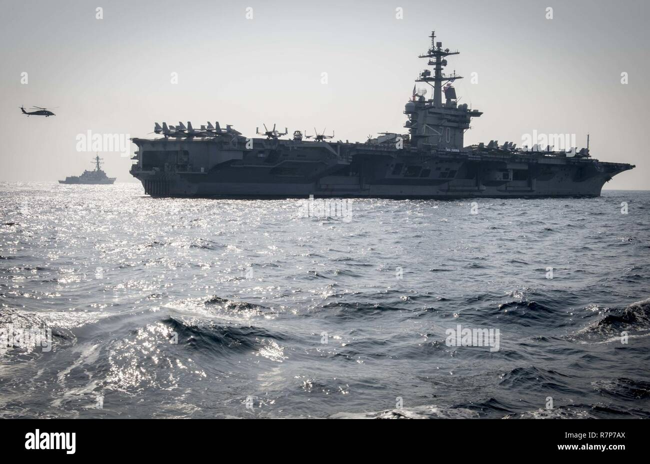 WATERS EAST OF THE KOREAN PENINSULA (March 22, 2017) The Nimitz-class aircraft carrier USS Carl Vinson (CVN 70) and the Arleigh Burke-class guided-missile destroyer USS Wayne E. Meyer (DDG 108) steam ahead of USS Stethem (DDG 63) during a surface maenuvers exercise with several other U.S. and Republic of Korea Navy ships and submarines during Foal Eagle (FE) 17. FE 17 is a series of annual training events designed to increase readiness to defend the ROK, protect the region, and maintain stability in the Korean Peninsula. - Stock Image