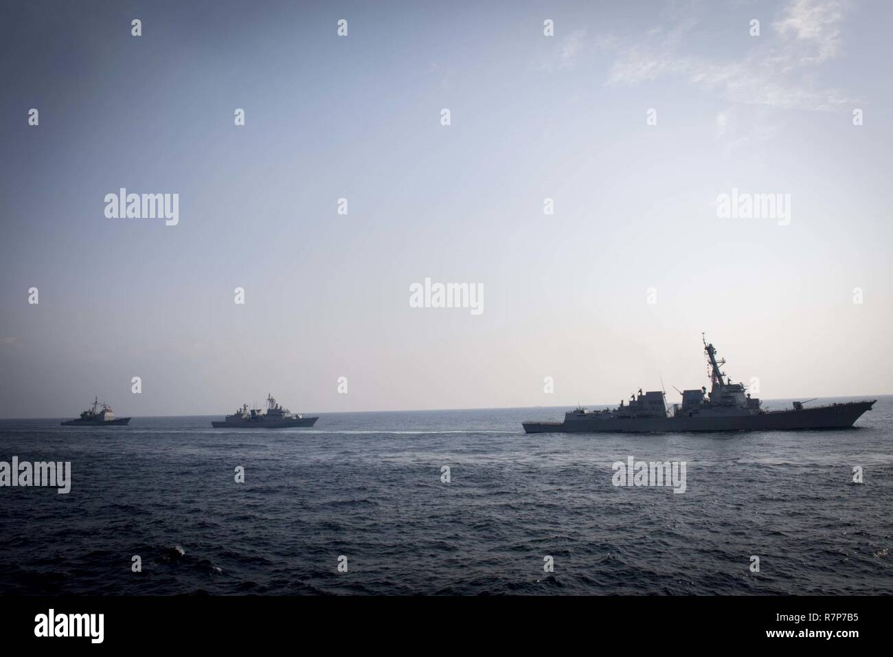 WATERS EAST OF THE KOREAN PENINSULA (March 22, 2017) The Arleigh Burke-class guided-missile destroyer USS Wayne E. Meyer (DDG 108), the Republic of Korea Navy destroyer ROKS Gwanggaeto the Great (DDH 971), and USS Mitscher (DDG 57) steam behind USS Stethem (DDG 63) as the ships participate in surface maneuvers with several other U.S. and Republic of Korea Navy ships and submarines during Foal Eagle (FE) 17. FE 17 is a series of annual training events designed to increase readiness to defend the ROK, protect the region, and maintain stability in the Korean Peninsula. - Stock Image