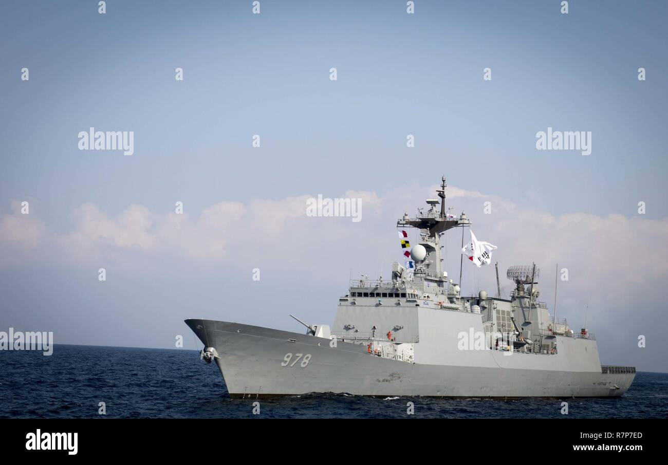 WATERS EAST OF THE KOREAN PENINSULA (March 22, 2017) The Republic of Korea Navy Chungmugong Yi Sun-sin-class guided-missile destroyer ROKS Wang Geon (DDG 978) steams behind the Arleigh Burke-class guided-missile destroyer USS Stethem (DDG 63) as the ships participate in surface maneuvers with several other U.S. and Republic of Korea Navy ships and submarines during Foal Eagle (FE) 17. FE 17 is a series of annual training events designed to increase readiness to defend the ROK, protect the region, and maintain stability in the Korean Peninsula. - Stock Image