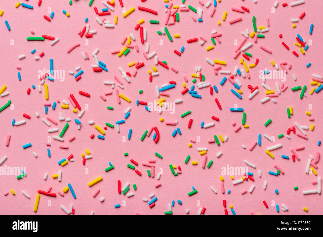 trendy pattern of colorful sprinkles over pink background