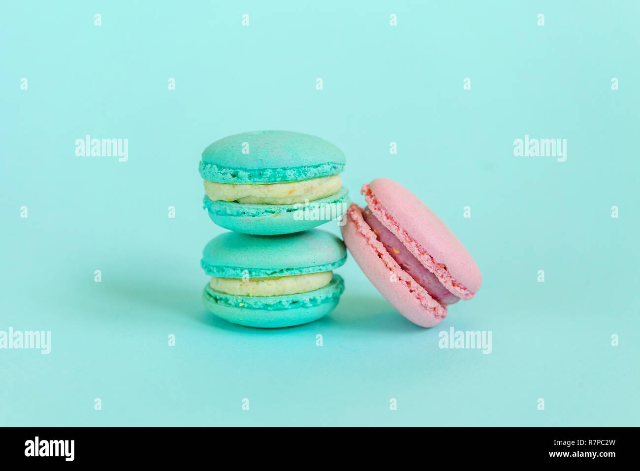 Sweet Almond Colorful Pink Blue Macaron Or Macaroon Dessert Cake Isolated On Trendy Blue Pastel Background French Sweet Cookie Minimal Food Bakery C Stock Photo Alamy