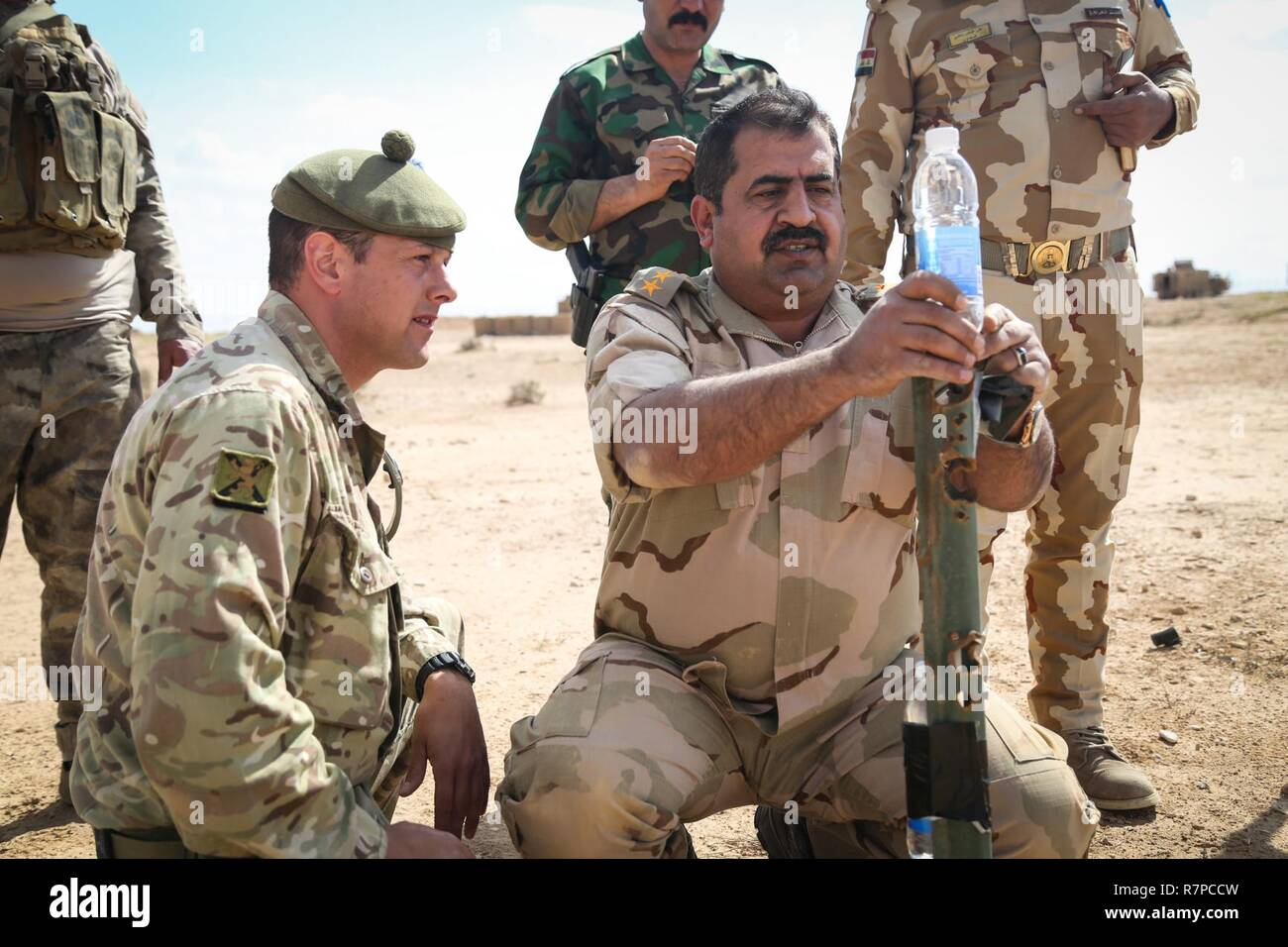 An Iraqi security forces colonel sets up a target during