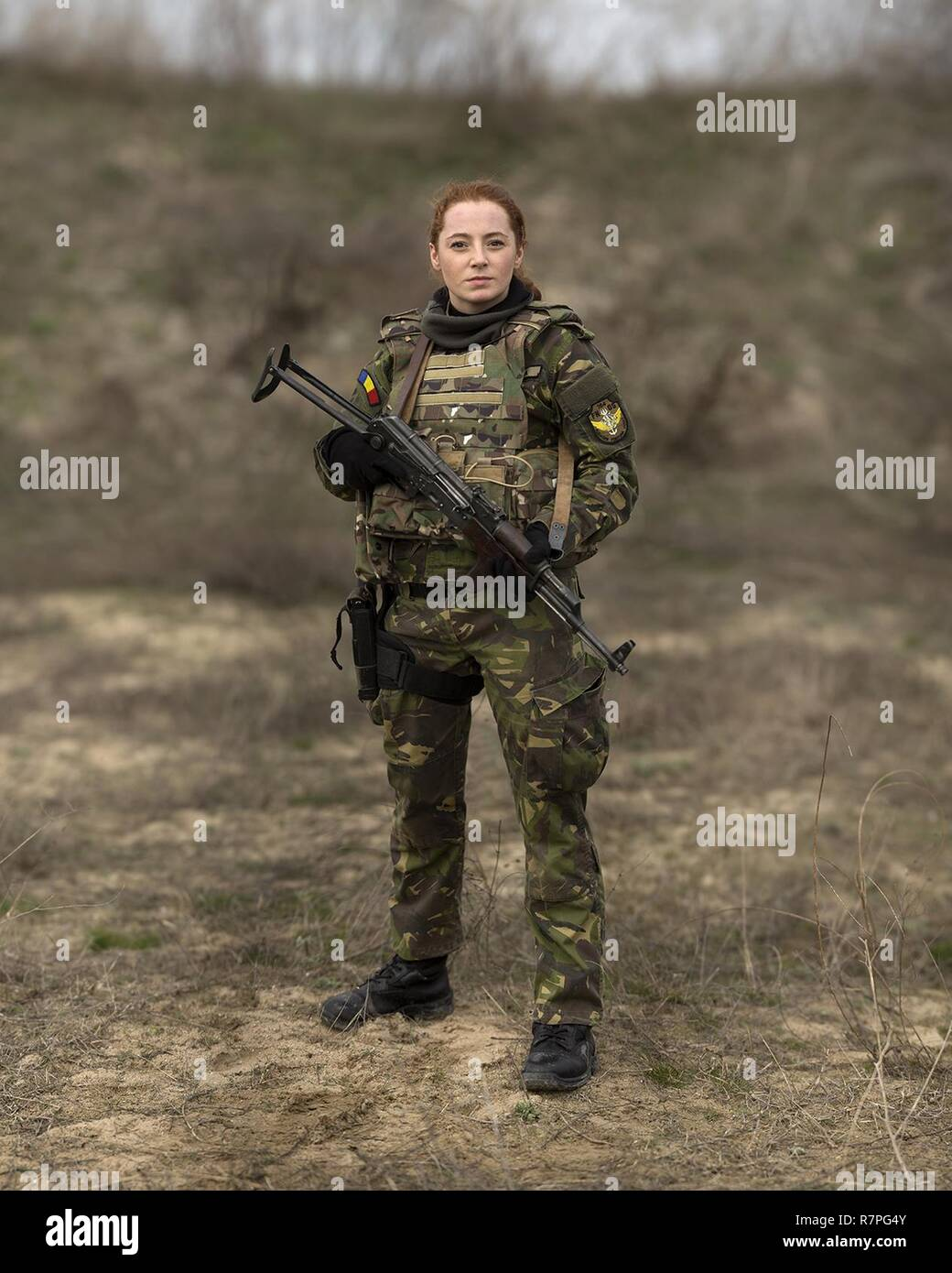 170320-M-IN448-243 CAPU MIDIA, ROMANIA (March 20, 2017)— Romanian Sailor Cpl. Pintilie Madalina, a communications specialist, poses for a portrait during a live-fire shoot with U.S. Marines of the 24th Marine Expeditionary Unit (MEU), Female Engagement Team, at Capu Midia training grounds in Romania March 20, during exercise Spring Storm 2017. The Marines trained for three days with their female Romanian counterparts in radio communication, detainee handling, personal security detail, tactical site exploitation and more, culminating in a live-fire rifle and pistol swap between the two forces.  Stock Photo