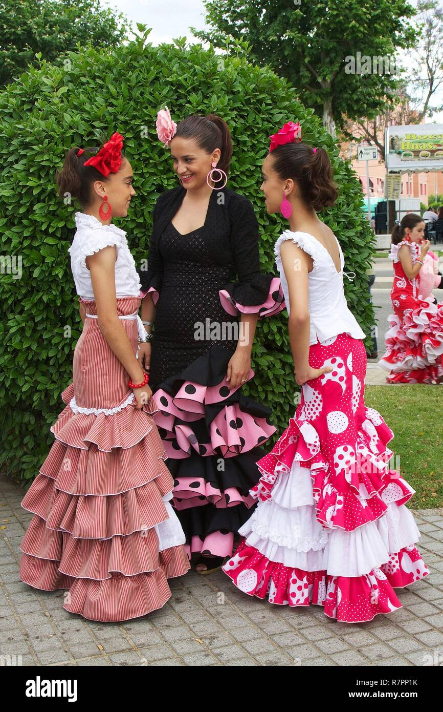 b331fca98de9 Spain, Andalusia, Cordoba, Woman and daughters in dress of flamenco during  the feria