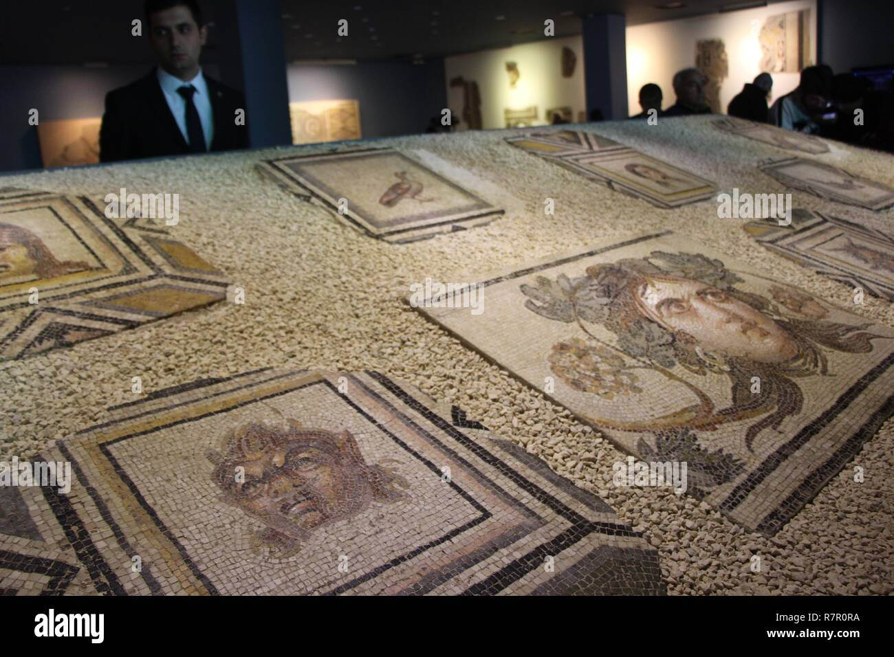 Ankara. 11th Dec, 2018. Photo taken on Dec. 8, 2018 shows fragments of the 'Gypsy Girl' mosaic painting in Gaziantep, southeastern Turkey. Looted and missing pieces of the famous 'Gypsy Girl' mosaic, found in the ancient Roman city of Zeugma which became the symbol of southeastern Turkey's Gaziantep, returned to Turkey recently from the United States after years of diplomatic efforts. Credit: Xinhua/Alamy Live News - Stock Image