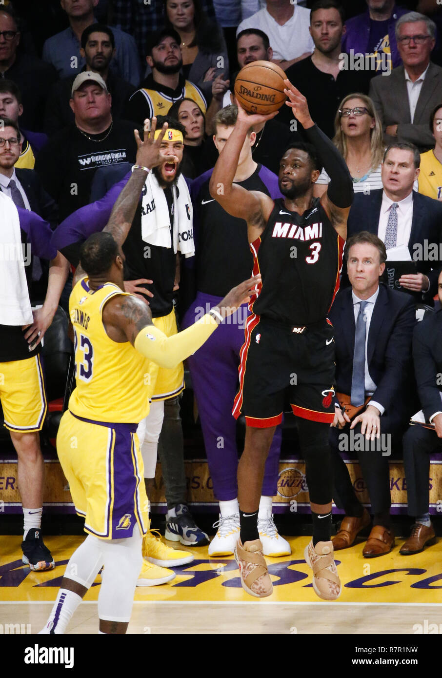 0af20dbc7083 Miami Heat s Dwyane Wade (3) shoots over Los Angeles Lakers  LeBron James  (23) in an NBA basketball game between Los Angeles Lakers and Miami Heat  Monday ...