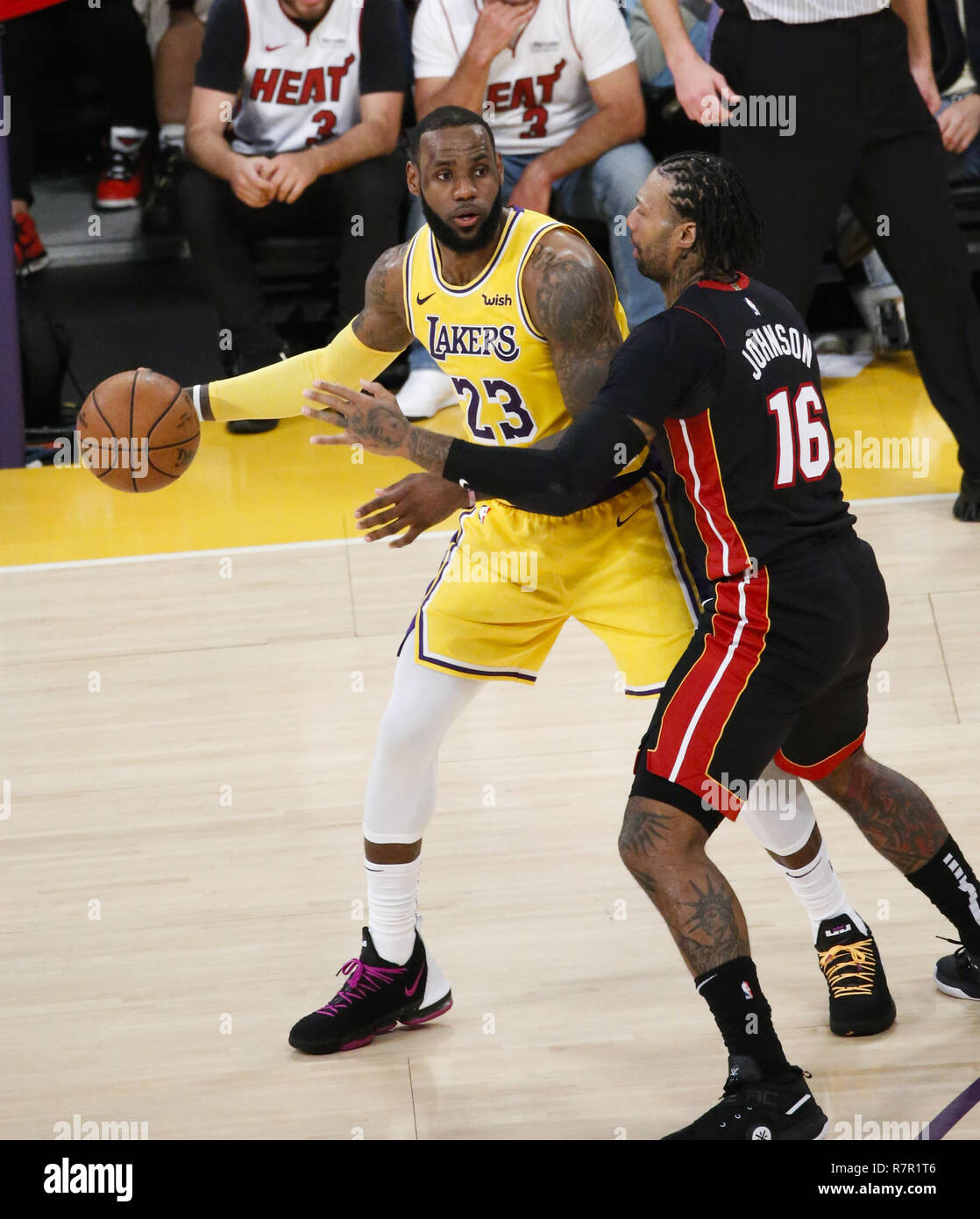 8bf41b4fe881 Los Angeles Lakers  LeBron James (23) is defended by Miami Heat s James  Johnson (16) in an NBA basketball game between Los Angeles Lakers and Miami  ...