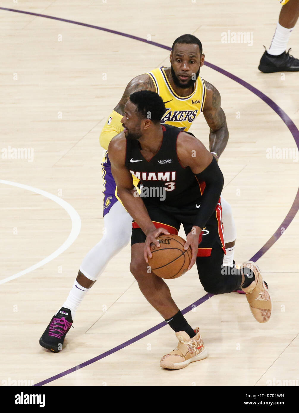 fd650f893915 Miami Heat s Dwyane Wade (3) is defended by Los Angeles Lakers  LeBron James  (23) in an NBA basketball game between Los Angeles Lakers and Miami Heat  Monday ...
