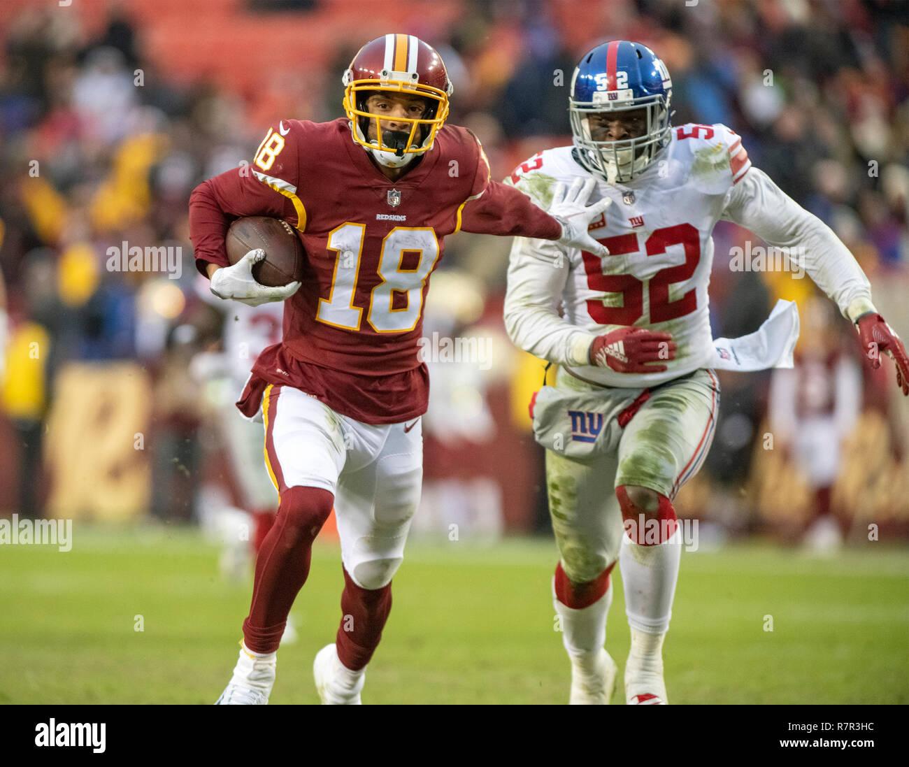 best cheap c1613 cc7a8 Washington Redskins wide receiver Josh Doctson (18) uses a ...