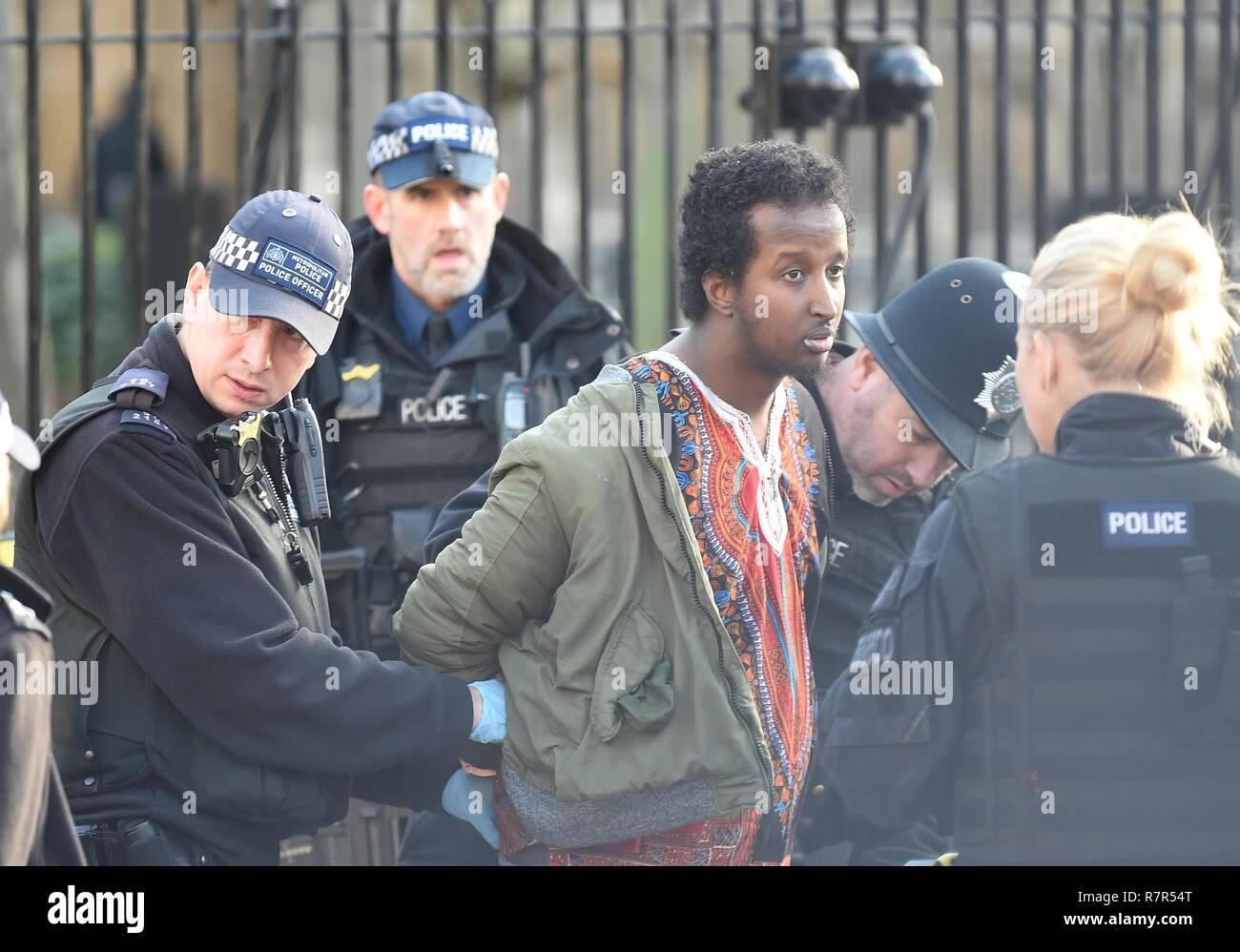 Intruder arrested inside the grounds of Parliament, Westminster, London Credit: Finnbarr Webster/Alamy Live News - Stock Image