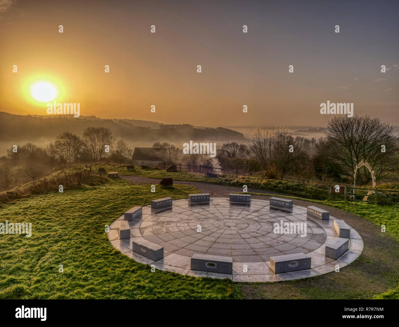 Wirksworth, Derbyshire Dales, Peak District, UK. 11th December, 2018. UK Weather: spectacular sunrise with cloud inversion at the star disc above Wirksworth in the Derbyshire Dales, Peak District National Park Credit: Doug Blane/Alamy Live News Stock Photo