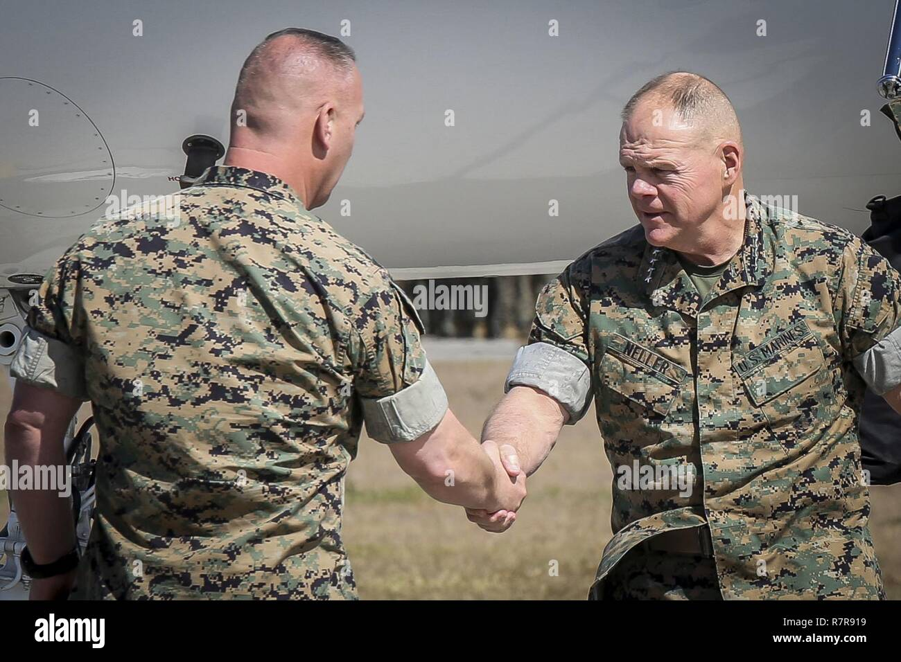 Col. Peter D. Buck greets Gen. Robert B. Neller, the 37th Commandant of the Marine Corps, during  a visit aboard Marine Corps Air Station Beaufort, March 24. Neller and Sgt. Maj. of the Marine Corps  Ronald Green, visited the air station to talk about the importance of respecting fellow Marines and  the Marine Corps' revised social media policy. Buck is the commanding officer of MCAS Beaufort. Stock Photo