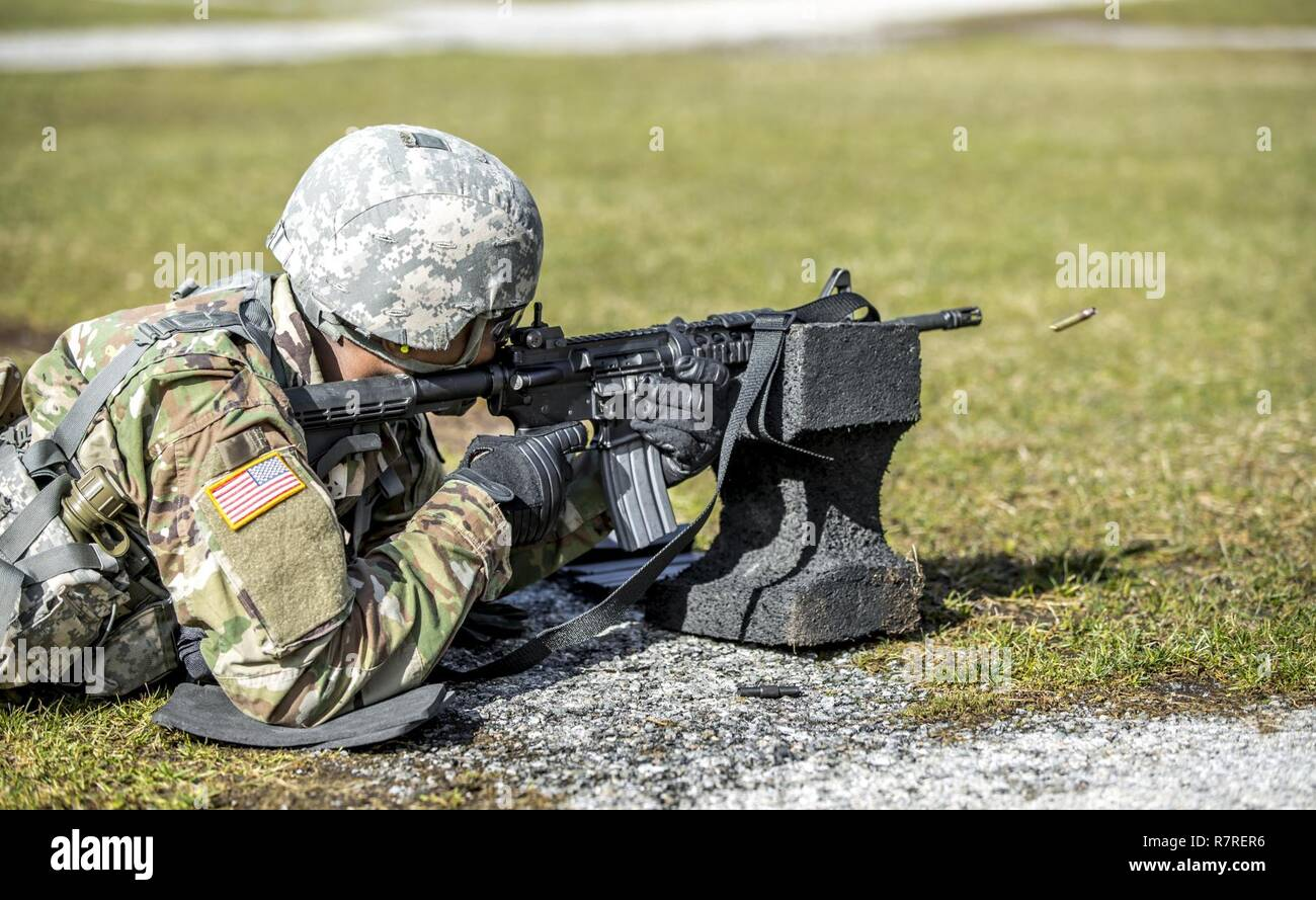 U.S. Army Pfc. Julius Forde zeroes his weapon before shooting a weapon qualification during the New York Army National Guard Best Warrior Competition at Camp Smith Training Site March 30, 2017. The Best Warrior competitors represent each of New York's brigades after winning competitions at the company, battalion, and brigade levels. Stock Photo