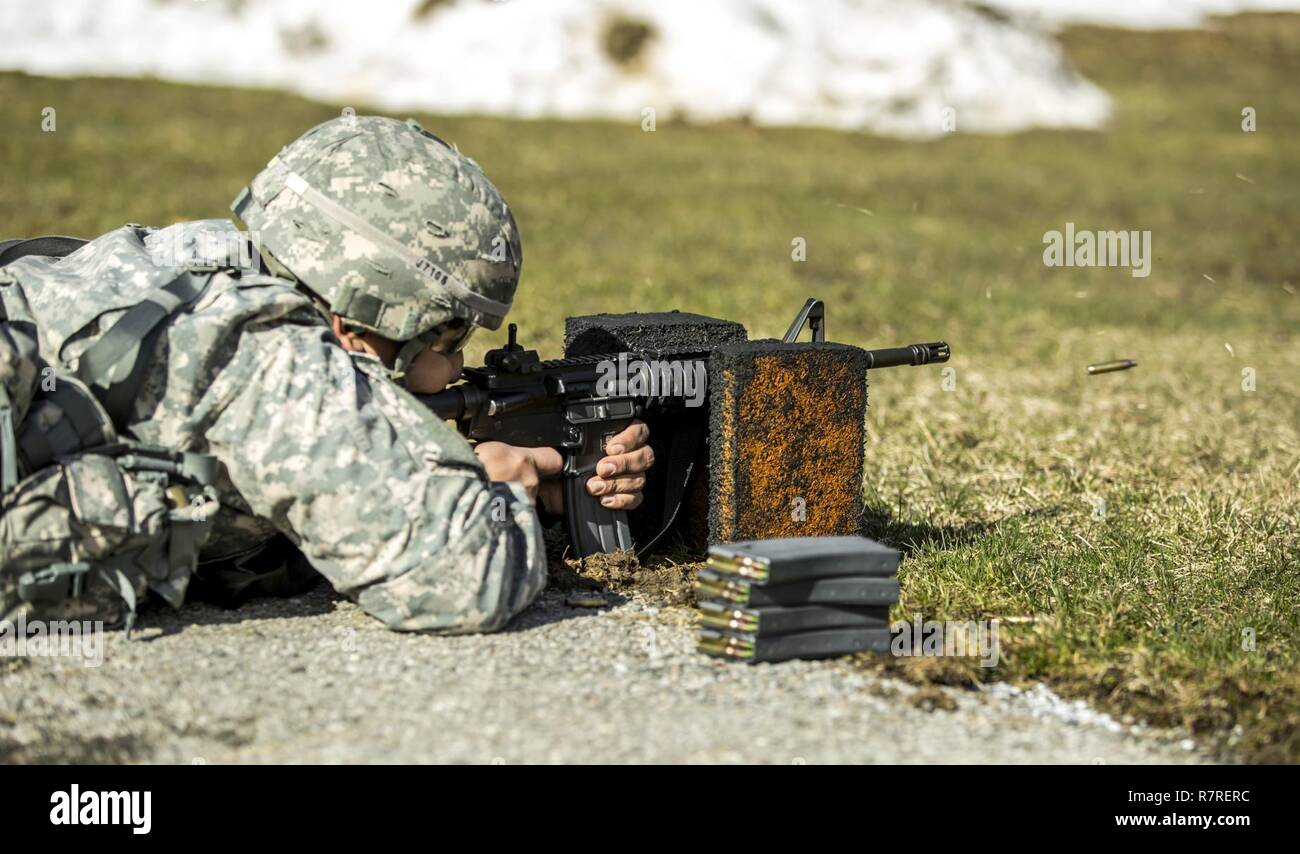 A Soldier zeroes his weapon before shooting a weapon qualification during the New York Army National Guard Best Warrior Competition at Camp Smith Training Site March 30, 2017. The Best Warrior competitors represent each of New York's brigades after winning competitions at the company, battalion, and brigade levels. At the state level they are tested on their physical fitness, military knowledge, endurance, marksmanship, and land navigation skills. Stock Photo
