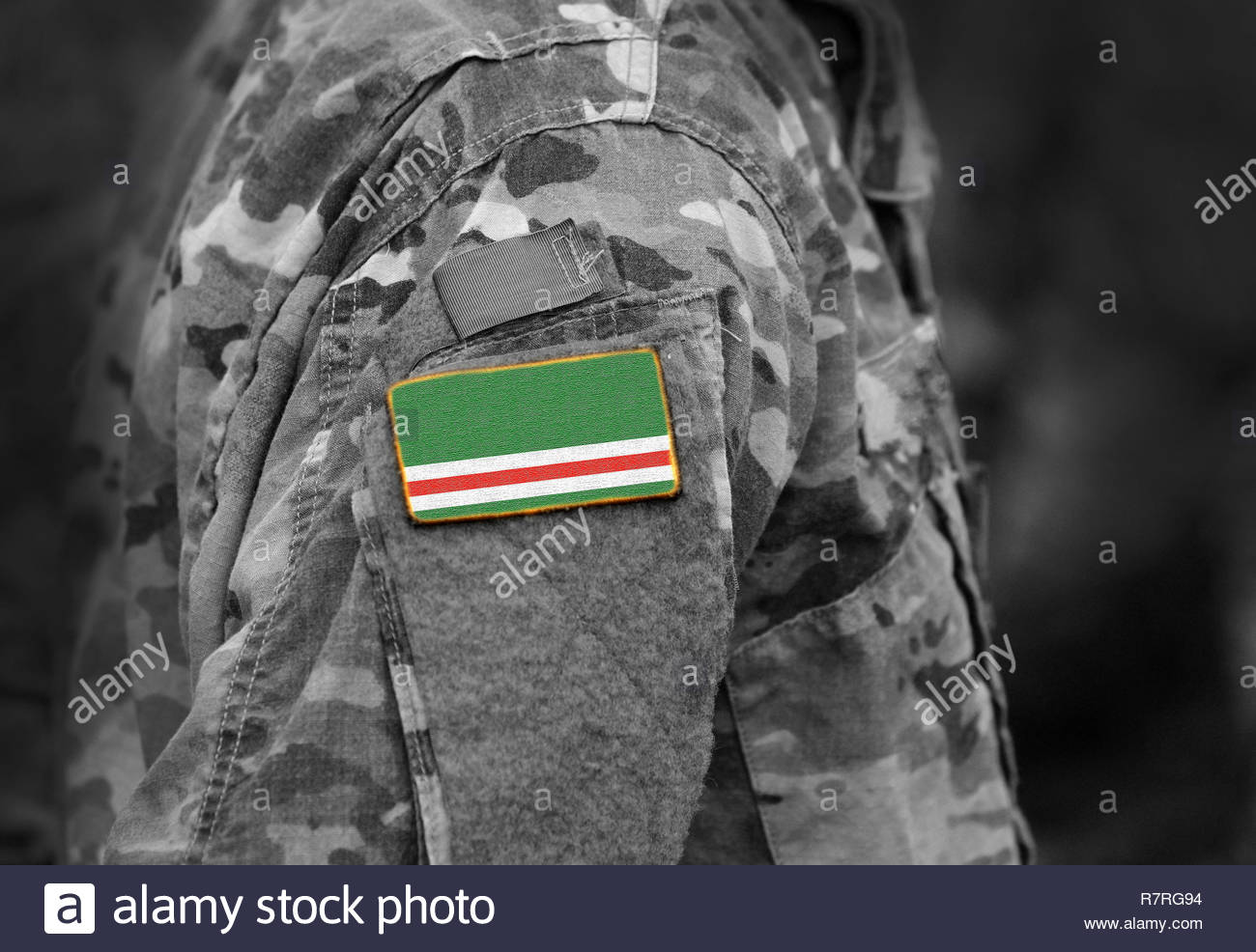 Flag of Chechen Republic of Ichkeria on military uniforms. Flag of Chechen Republic of Ichkeria on soldiers arm.  (collage). - Stock Image