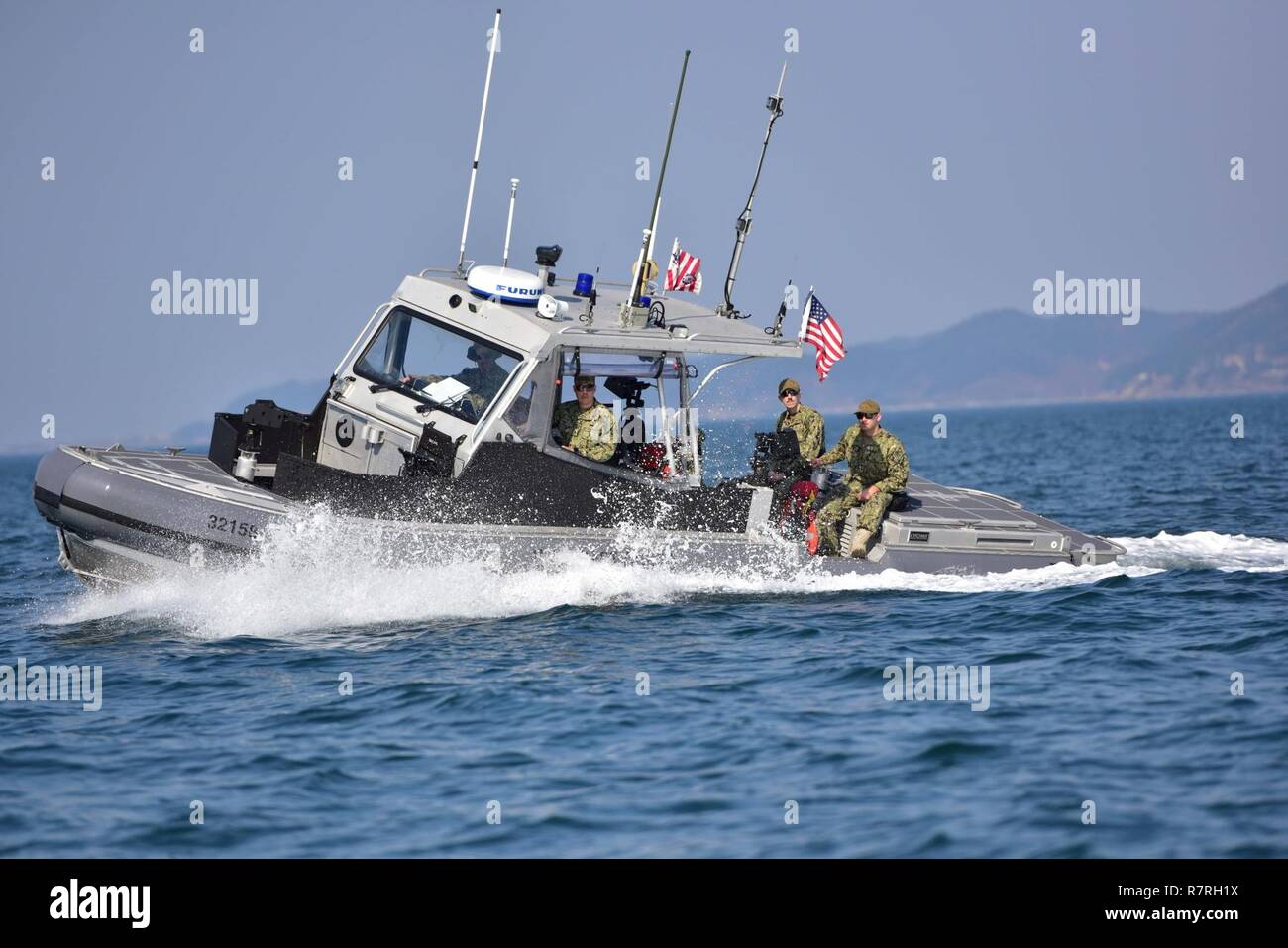 U.S. Coast Guardsmen assigned to Coast Guard Port Security Unit 312 conduct an underway area familiarization patrol aboard a 32-foot transportable port security boat during Operation Pacific Reach Exercise 2017 (OPRex17) in Pohang, South Korea, April 2, 2017. OPRex17 is a bilateral training event designed to ensure readiness and sustain the capabilities which strengthen ROK-U.S. Alliance. Stock Photo