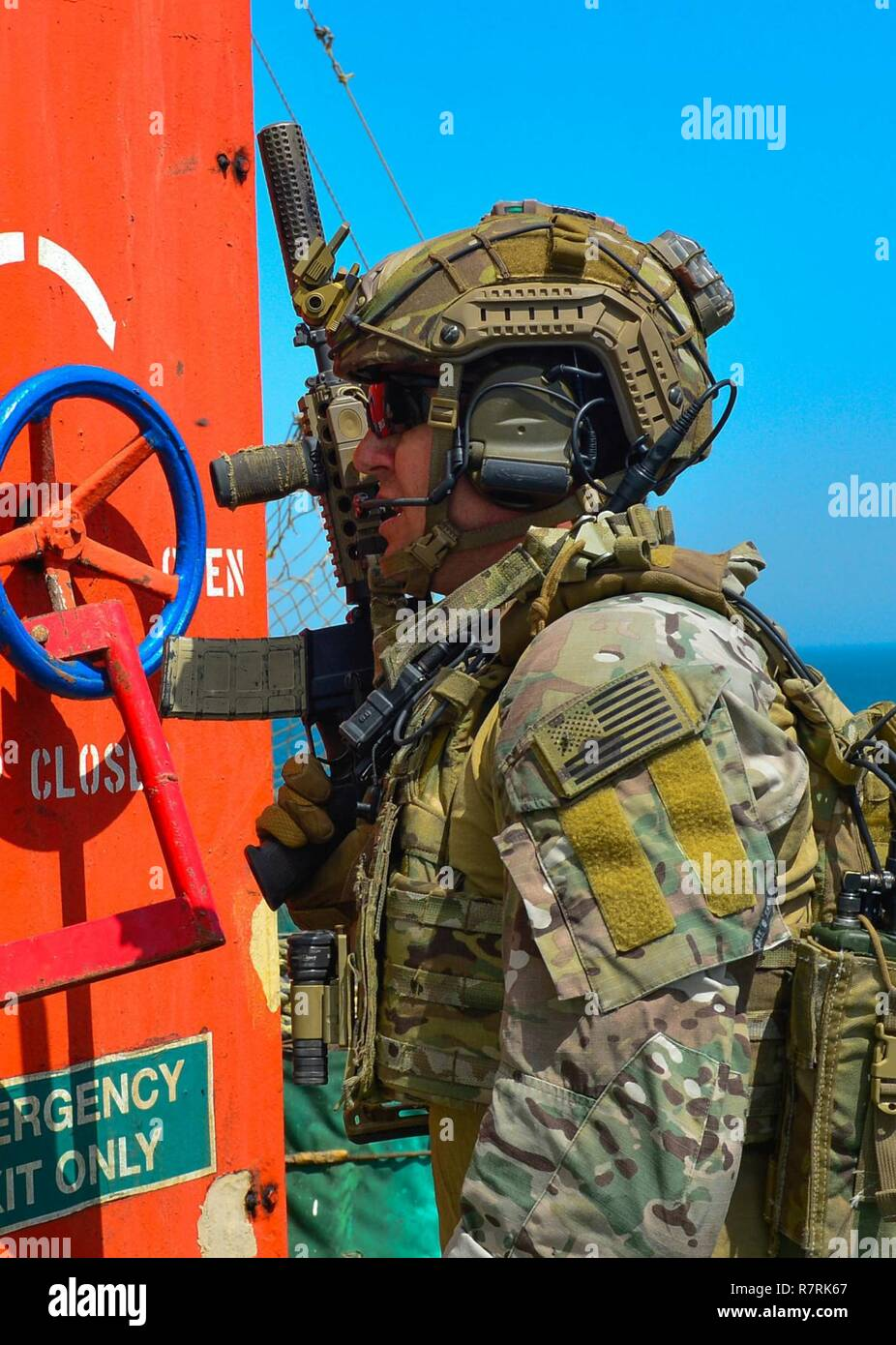 KUWAIT - Elite military special operations forces from the Gulf Cooperation Council,  and the U.S. conducted a simulated rapid response to the hijacking of the motor tanker, or oil tanker, the Hadiyah, April 3, in Kuwait territorial waters.   Special forces teams from the GCC, and U.S. Naval Special Warfare and rigid-hull inflatable boat teams simulated an air and sea-borne rapid insertion, search and seizure of the occupied tanker and its hijackers, and the safe release of the tanker crewmen.  The raid was a cumulative joint exercise that tested the participants' tactical skills and abilities Stock Photo