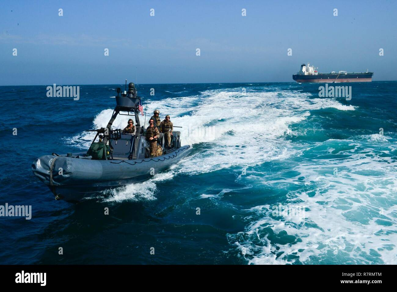 KUWAIT - A U.S. Navy special warfare combatant craft crew returns from a simulated mission to recover a hijacked tanker Apr 3, in Kuwait territorial waters as part of exercise Eagle Resolve 2017. - Stock Image