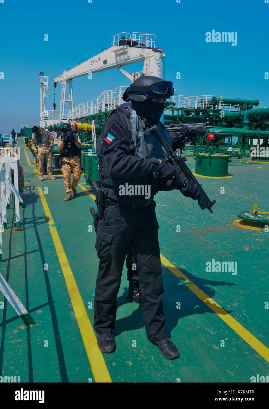KUWAIT - Gulf Cooperation Council special operations forces conduct a simulated search and seizure of the hijacked oil tanker, the Hadiyah, April 3, in Kuwait territorial waters as part of exercise Eagle Resolve 2017. Stock Photo