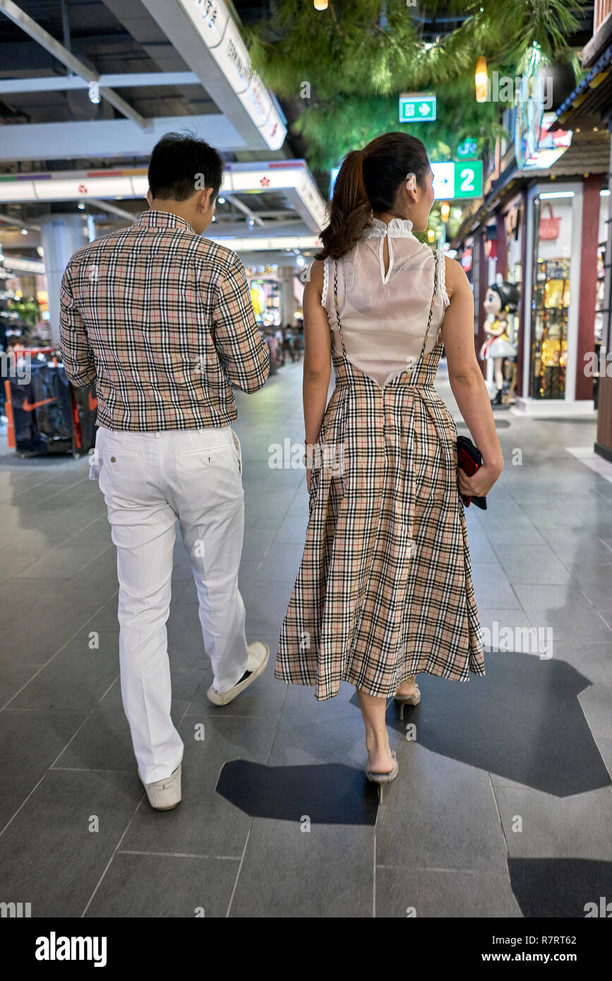 Matching clothes. Couple wearing matching coordinated clothing - Stock Image