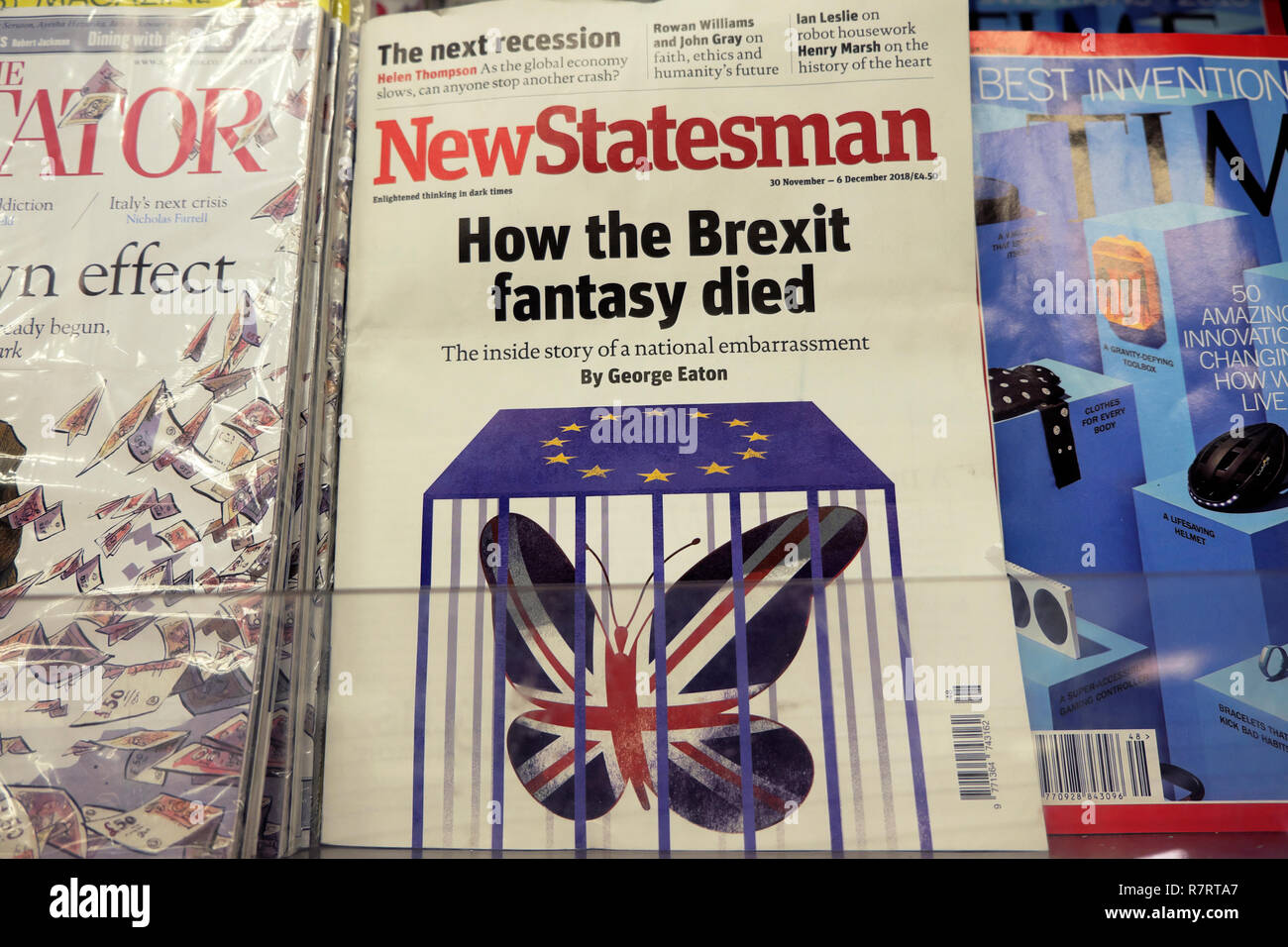 """New Statesman """"How the Brexit fantasy died"""" front cover on a magazine shelf at a British newsagent shop in London England Stock Photo"""