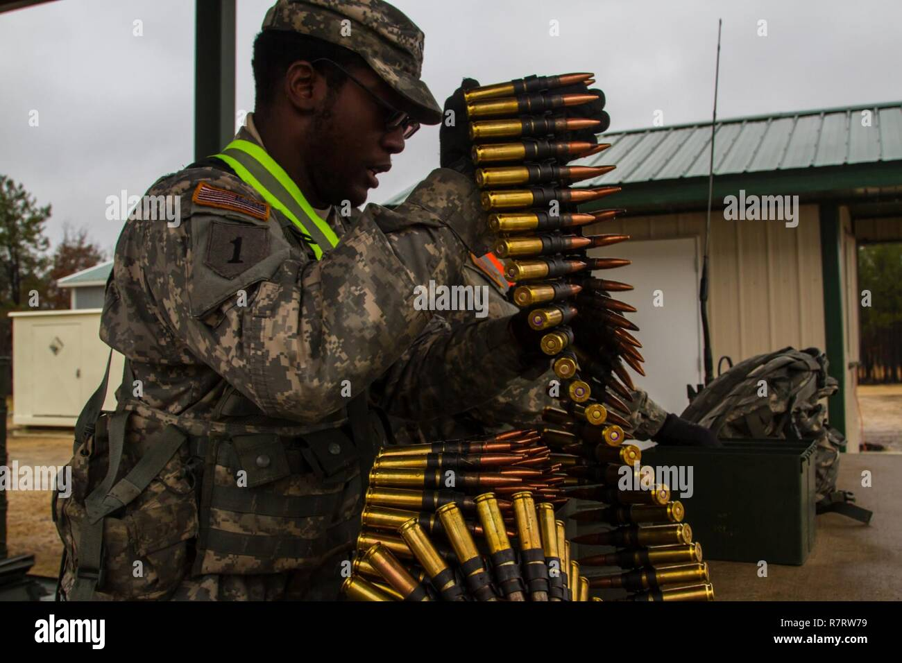 US Army Reserve Spc. Calvin Gray a motor transport operator with the 416th Theater Engineer Command and Pvt. 1st Class Donte Henderson a power generation equipment repairer with the 354th civil affairs company, 351st Civil Affairs Command prep .50 caliber machine gun ammunition to be given to the firing teams during a live fire exercise at Range 26 on Fort McCoy, Wis., for Operation Cold Steel, April 03, 2017. Operation Cold Steel is the U.S. Army Reserve's crew-served weapons qualification and validation exercise to ensure that America's Army Reserve units and Soldiers are trained and ready t Stock Photo