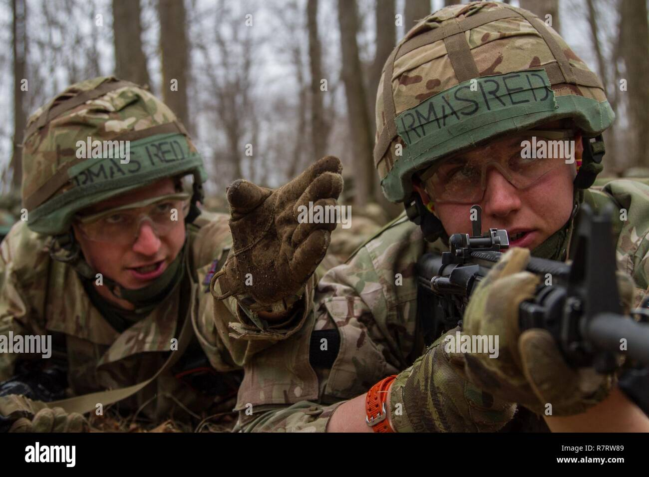 A British army cadet squad leader directs a fellow cadet on