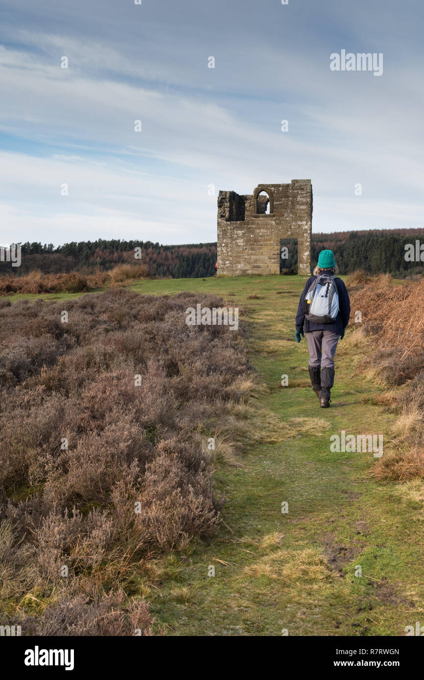 A walker approaching Skelton Tower overlooking Newtondale in the North York Moors Stock Photo