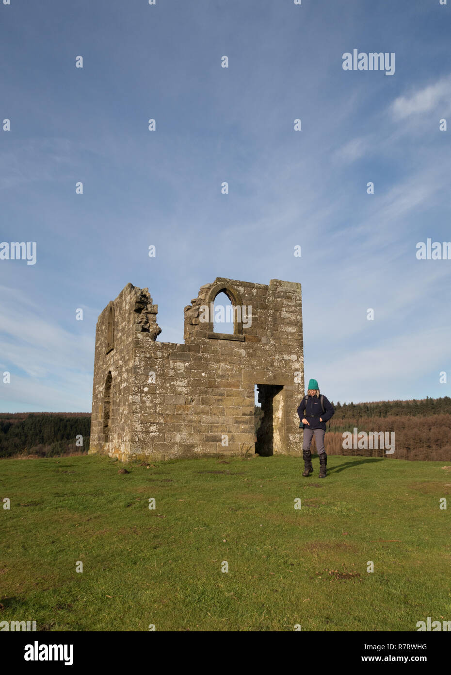 A walker near Skelton Tower, overlooking Newtondale in the North York Moors - Stock Image
