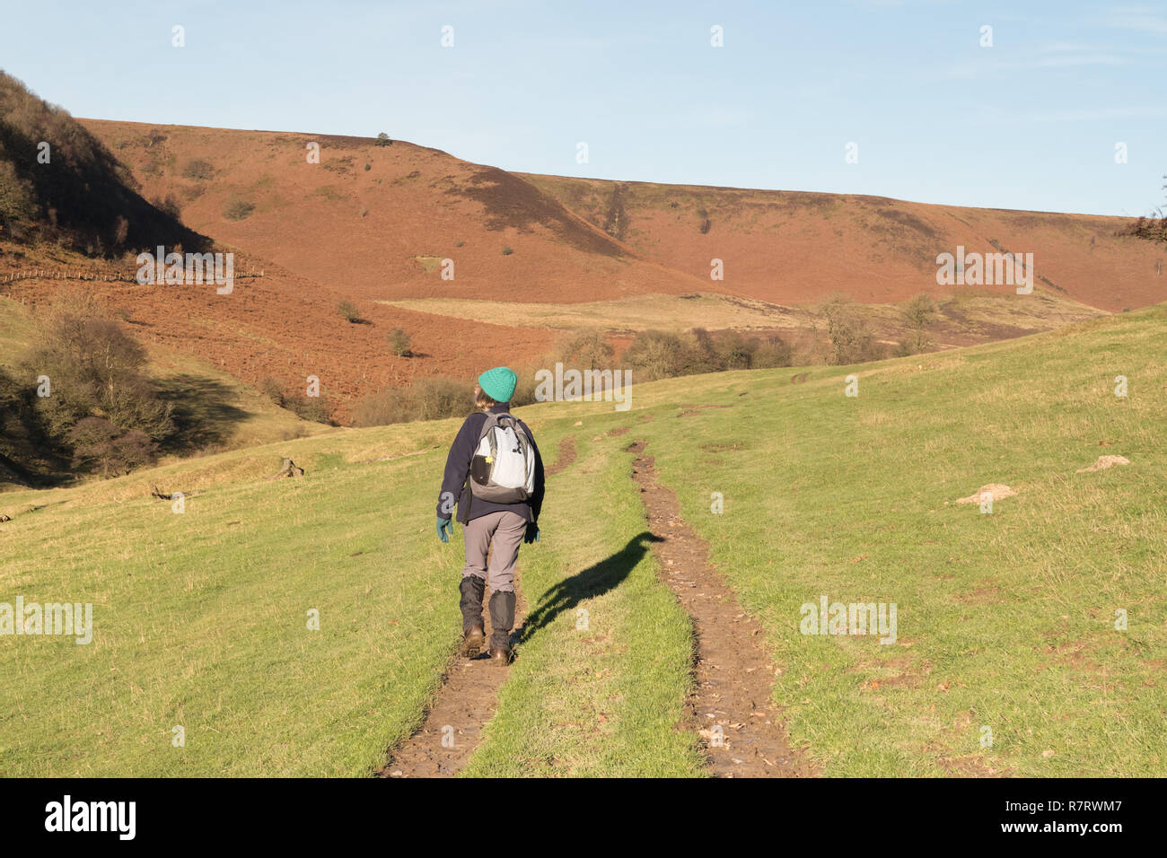 A walker heading through Horcum Slack near the Hole of Horcum in the North York Moors - Stock Image