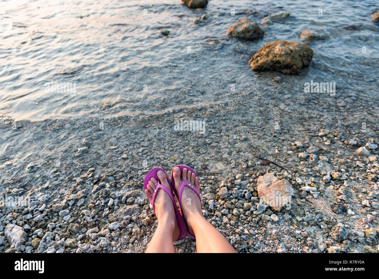 b2769b8665a1 Young woman looking down pov point of view perspective on feet flip-flops  sandals sitting