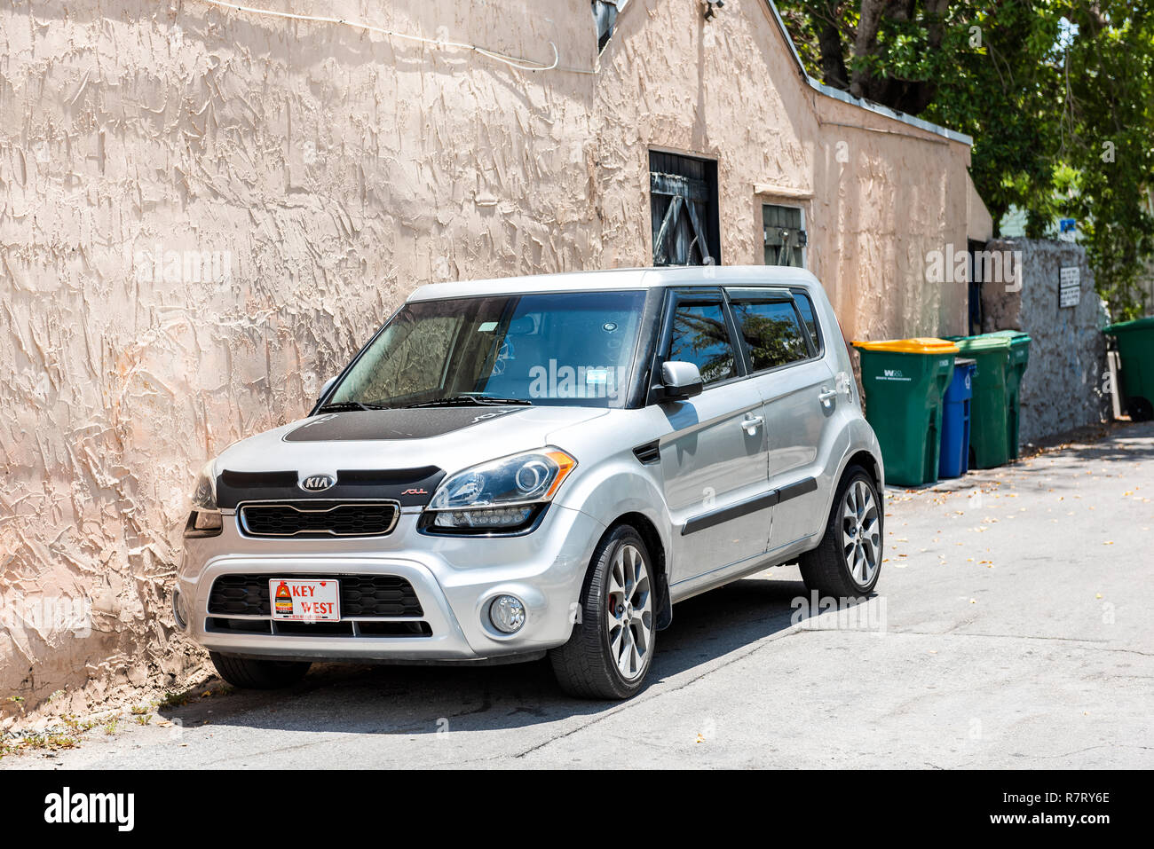 Key West, USA - May 1, 2018: Local car on street with license plate sign in Florida city travel, sunny day, parallel parked on street Stock Photo