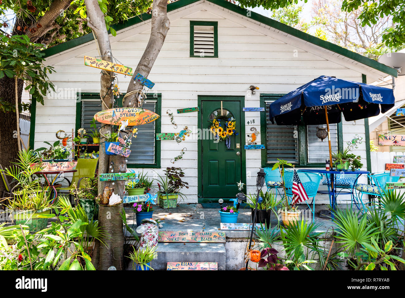 Key West, USA - May 1, 2018: Architecture of house in Florida city island on travel, sunny day, many decorations, local colorful design Stock Photo